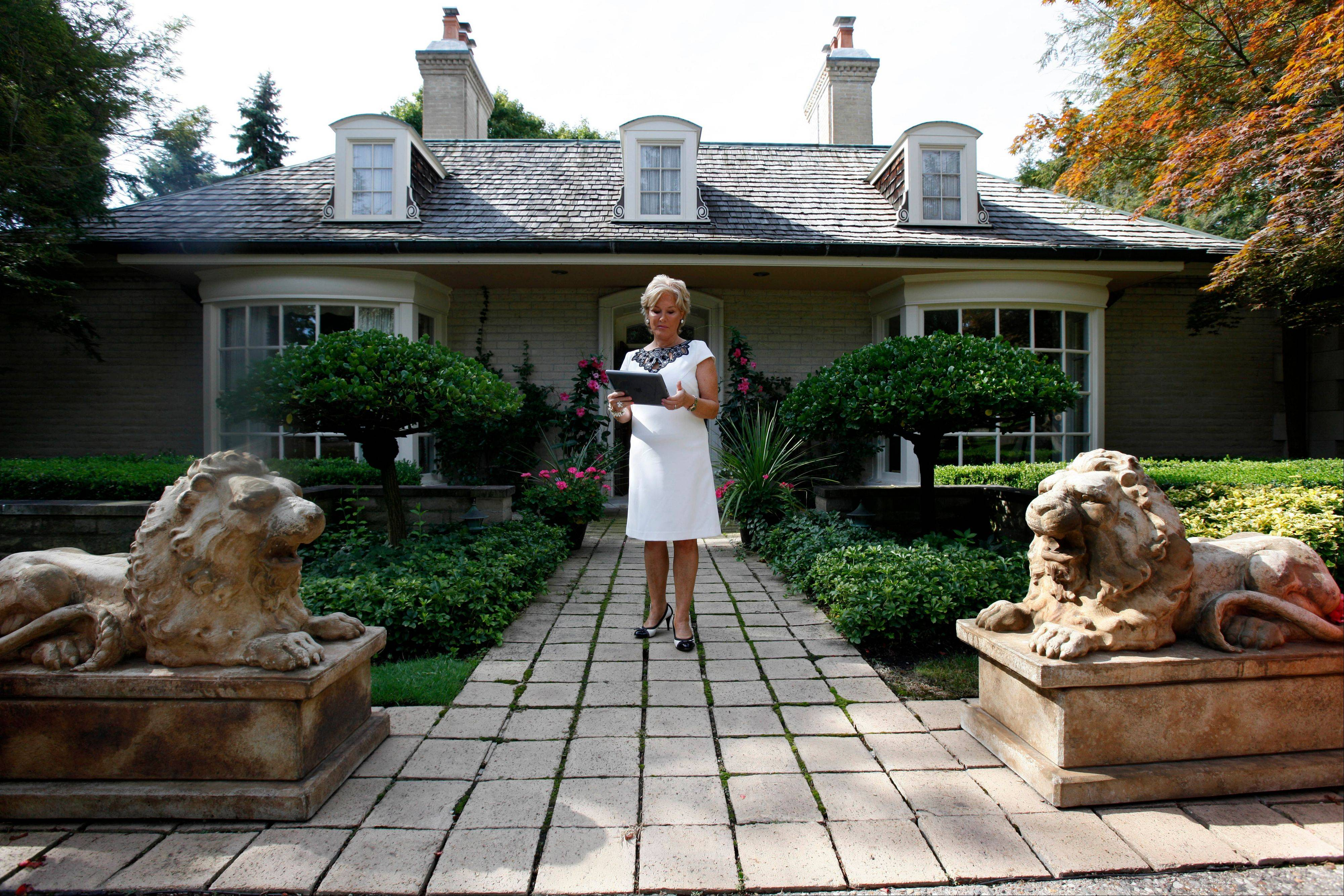Real estate agent Ronni Keating waits outside for a client to view a home in Bloomfield Hills, Mich. Think of this housing market as bipolar. In the luxury sector, the recession is a memory and sales and prices are rising. But everywhere else, the market is moving sideways or getting worse.