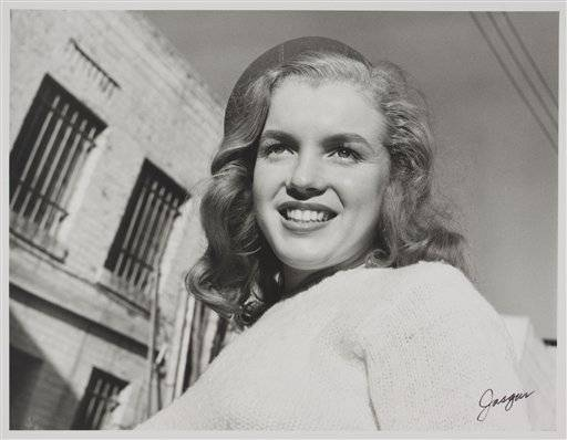 In this 1946 image taken by photographer Joseph Jasgur and released by Julien's Auctions, is a photo of Norma Jean Dougherty, who eventually changed her name to Marilyn Monro.