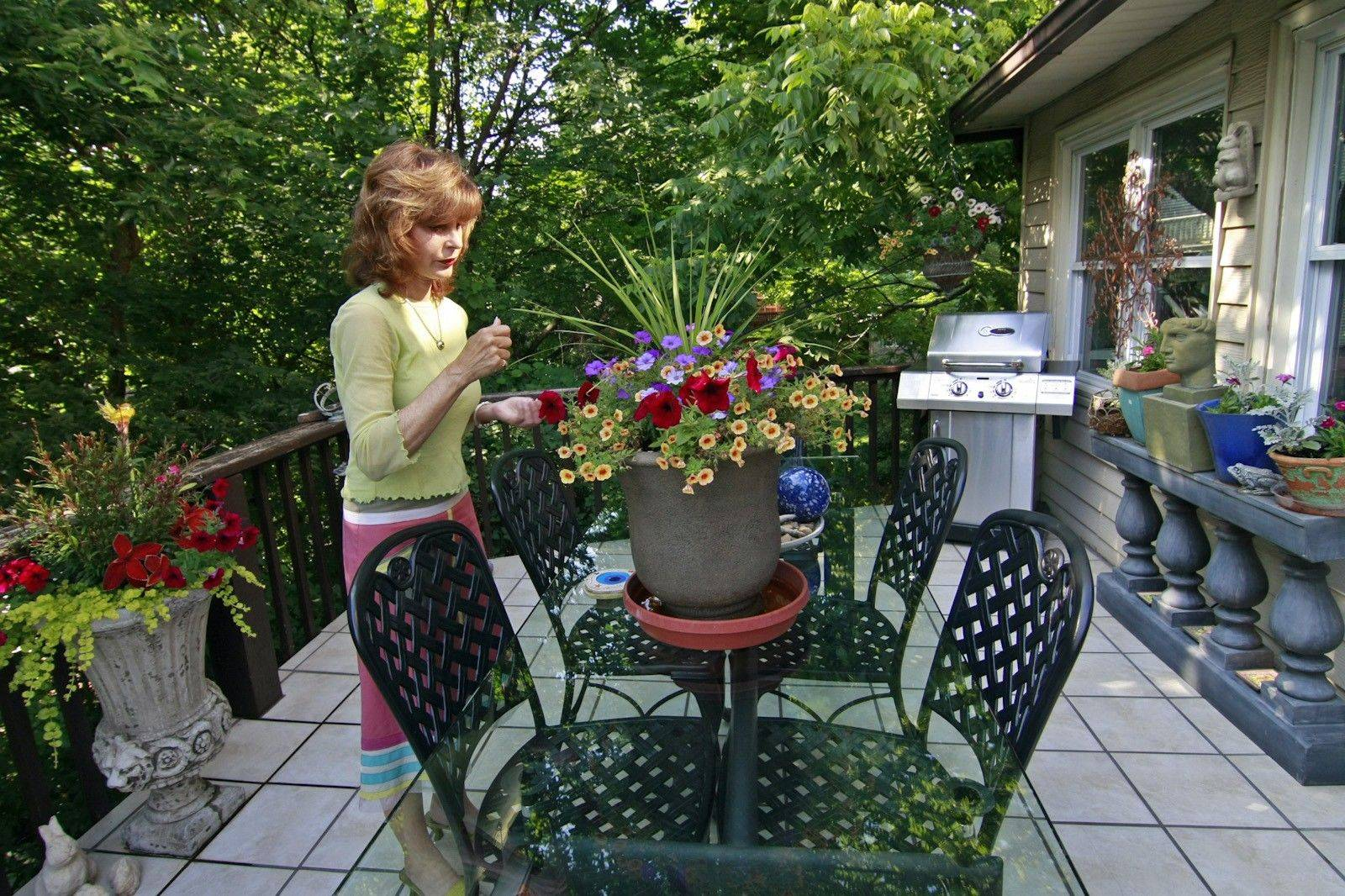 Christine Clifford arranges a bouquet on her home's balcony, an area ideal for entertaining.