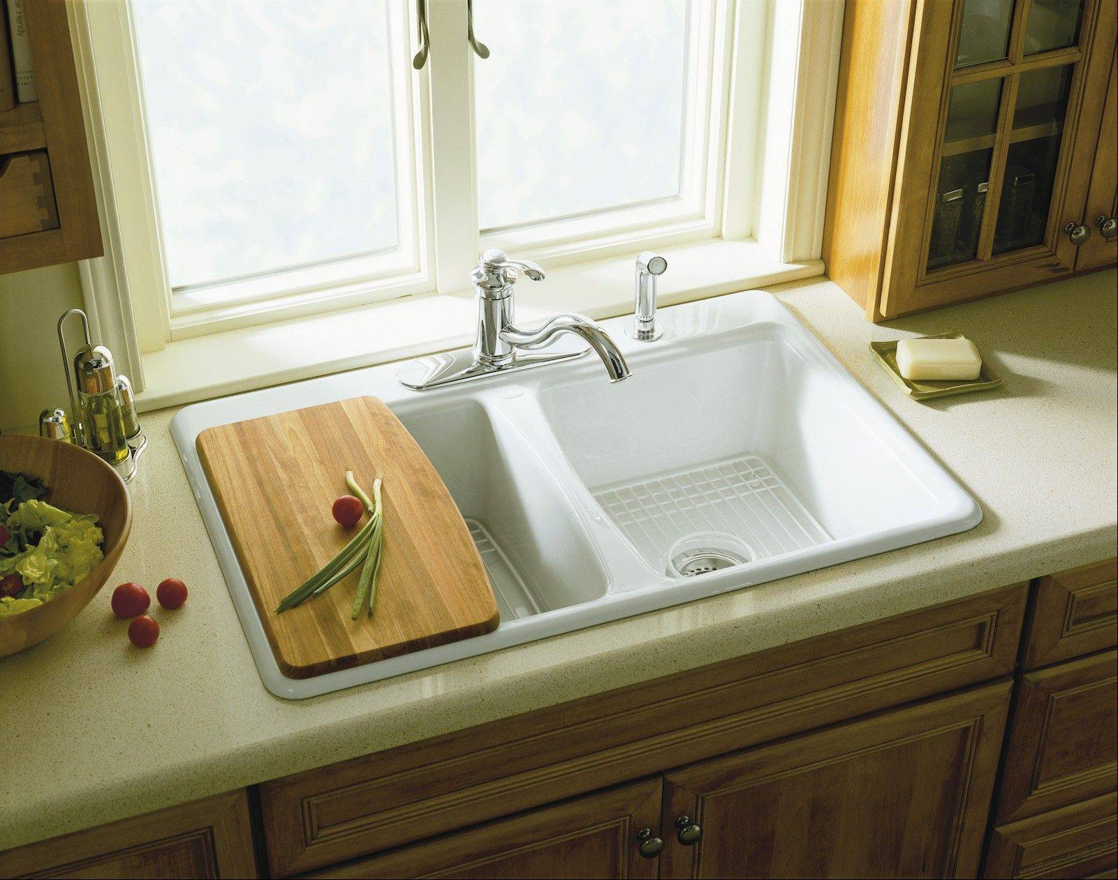 Buy a kitchen sink from a manufacturer that offers custom-made accessories.