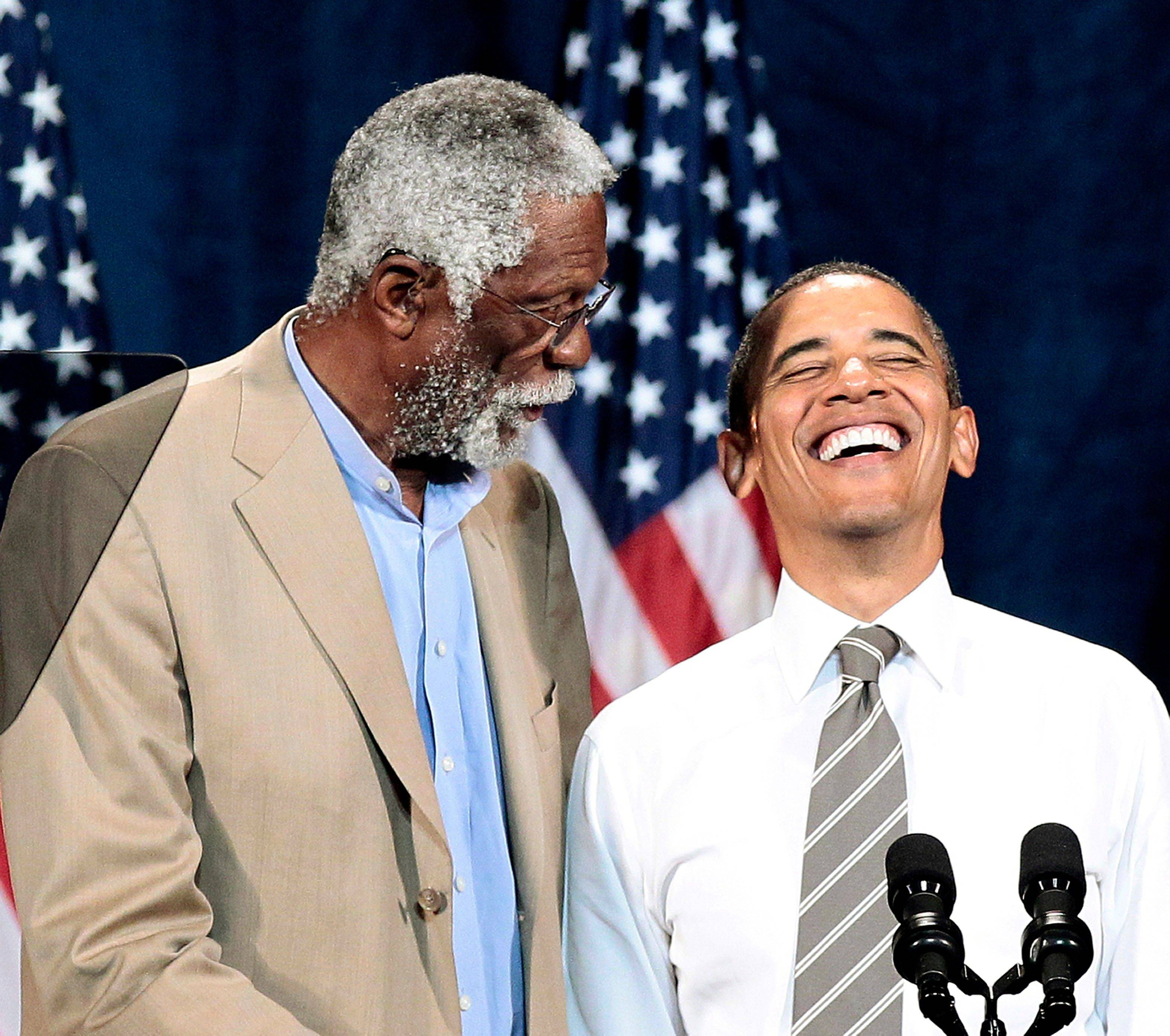 President Barack Obama is introduced by NBA Hall of Fame player Bill Russell during a Democratic fundraiser Sunday in Seattle.
