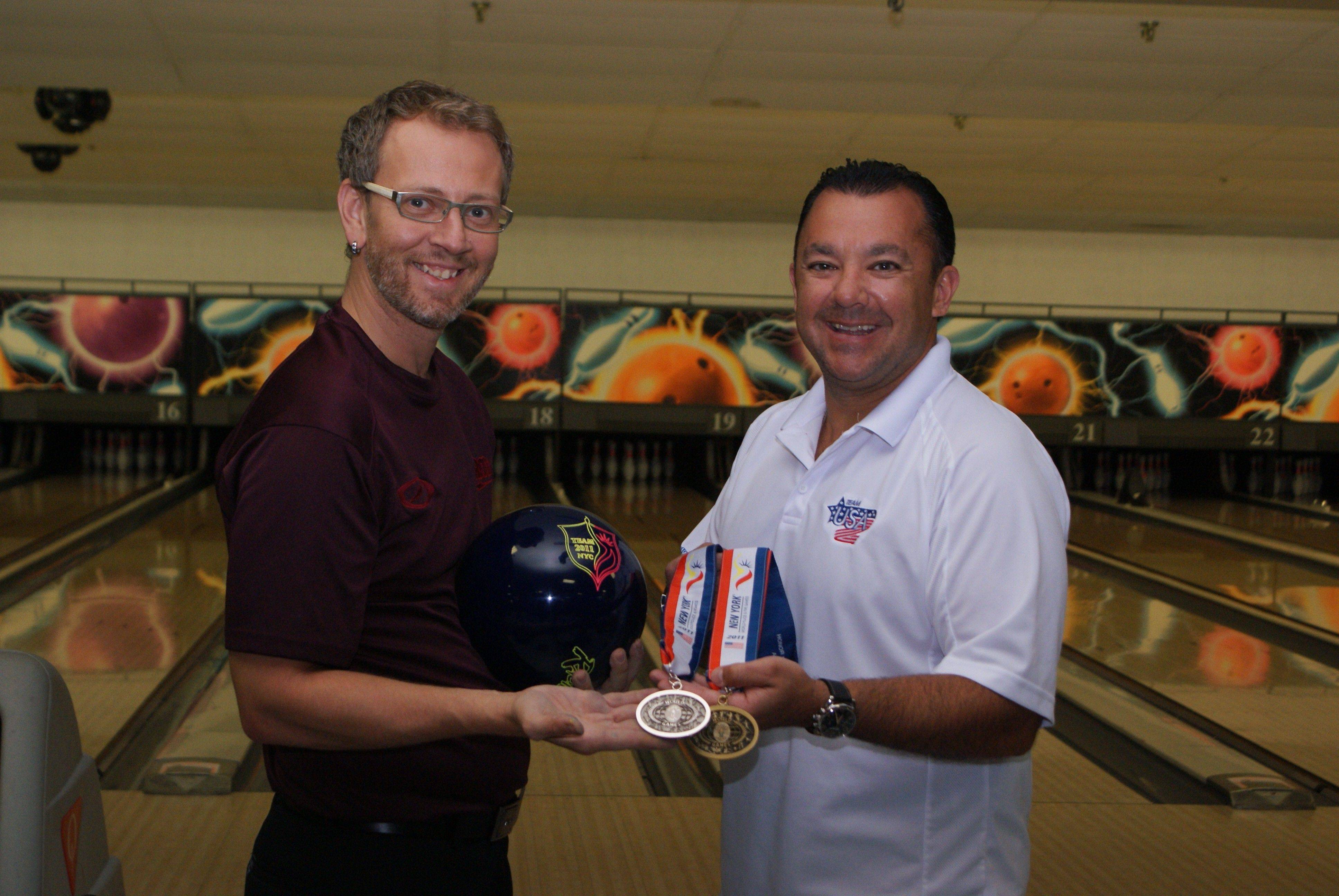 William Clark, left, owner of the pro shop at River Rand Bowl in Des Plaines, coached Dale Torii with the Rosemont Public Safety Department, who brought home silver and bronze medals for bowling at the World Police & Fire Games earlier this month in New York.