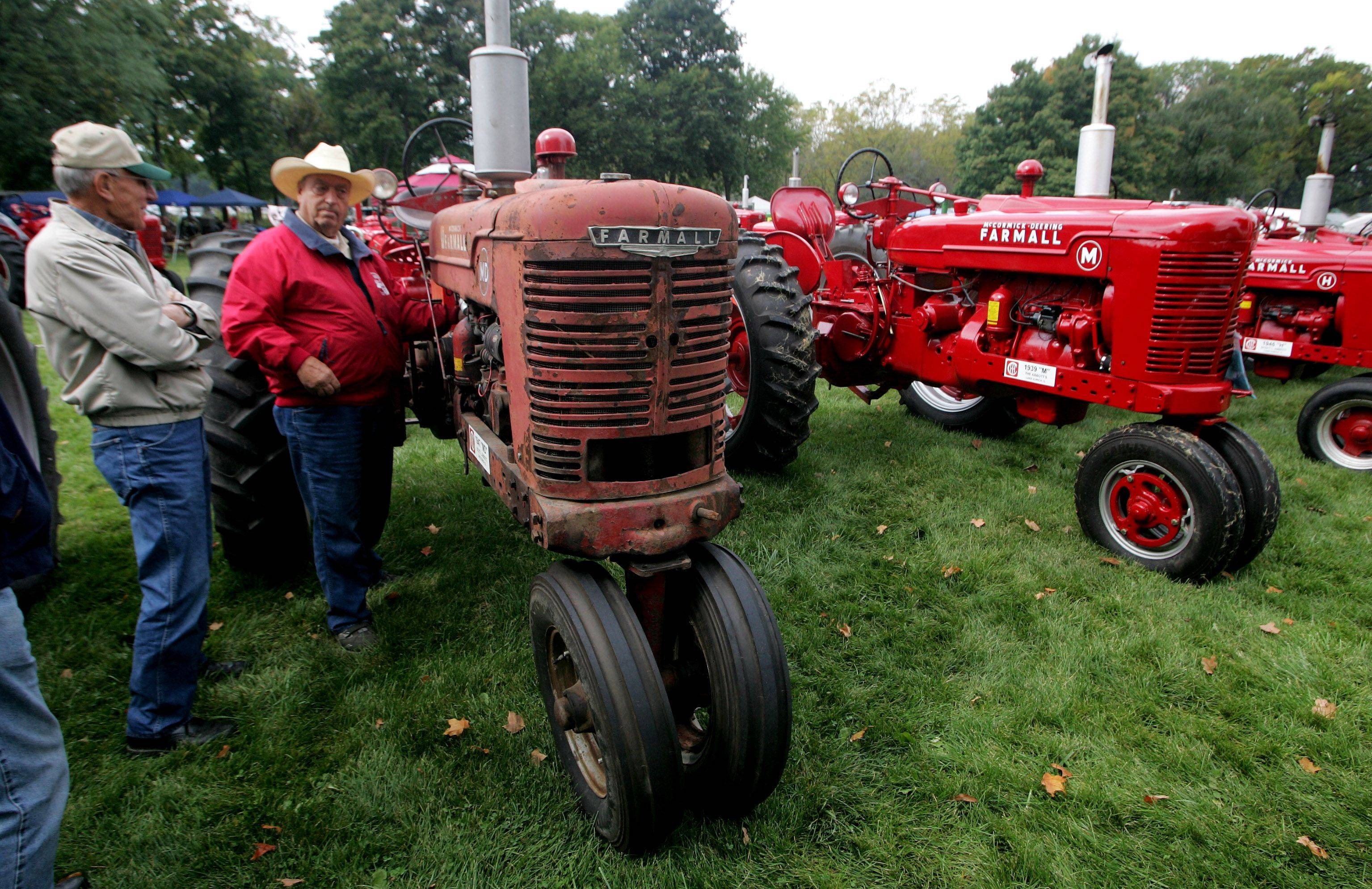 Terry Abbott, right, of Lake Zurich talks to Milan Duchaj of Hampshire about his 1947 McCormick Farmall �MD� during the Farm Heritage Festival Sunday at Lakewood Forest Preserve near Wauconda. The event celebrates farm life from the turn of the century to present day.