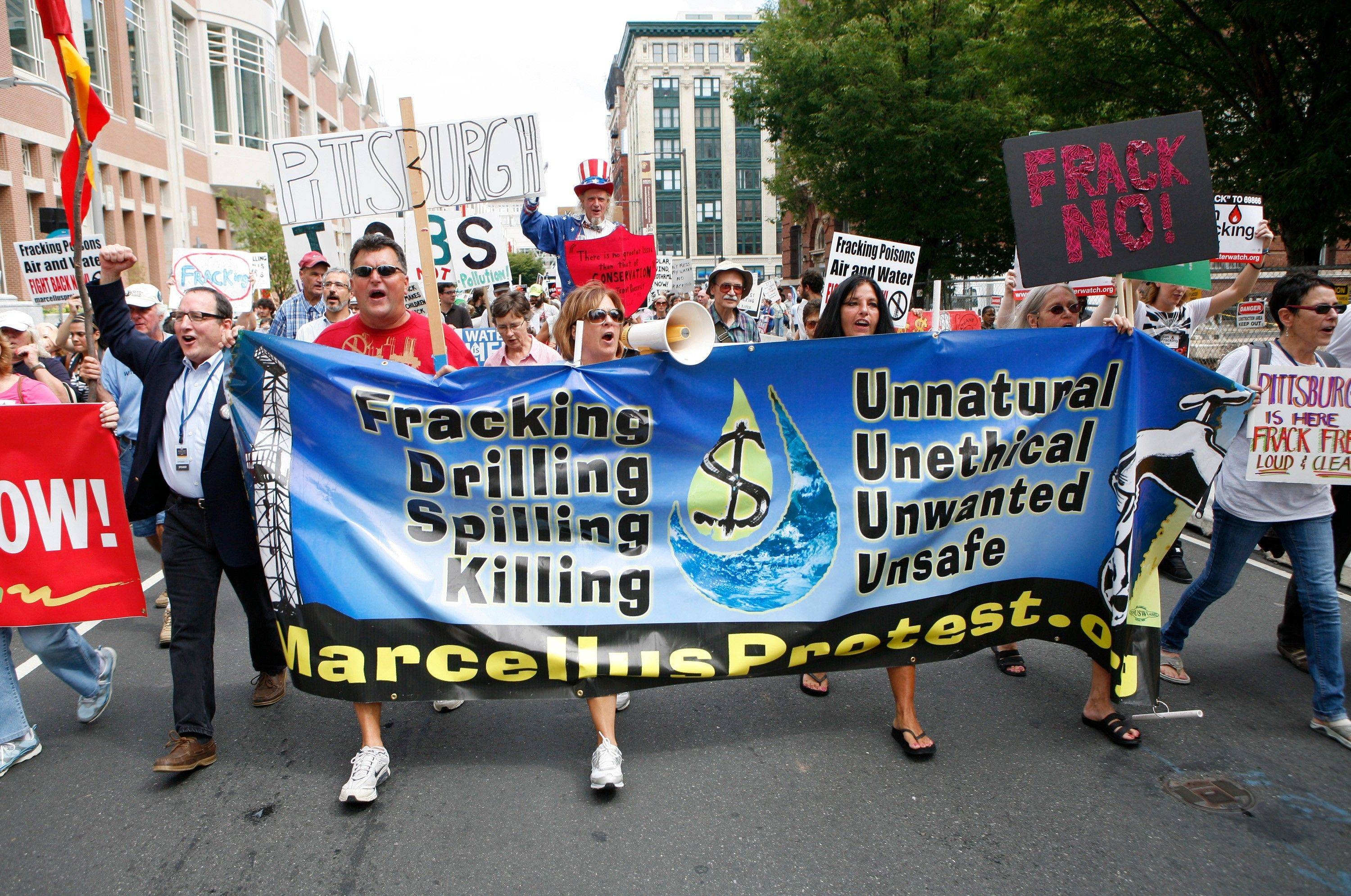 Activists and homeowners march in Philadelphia following a protest against hydraulic gas drilling, or �fracking.�