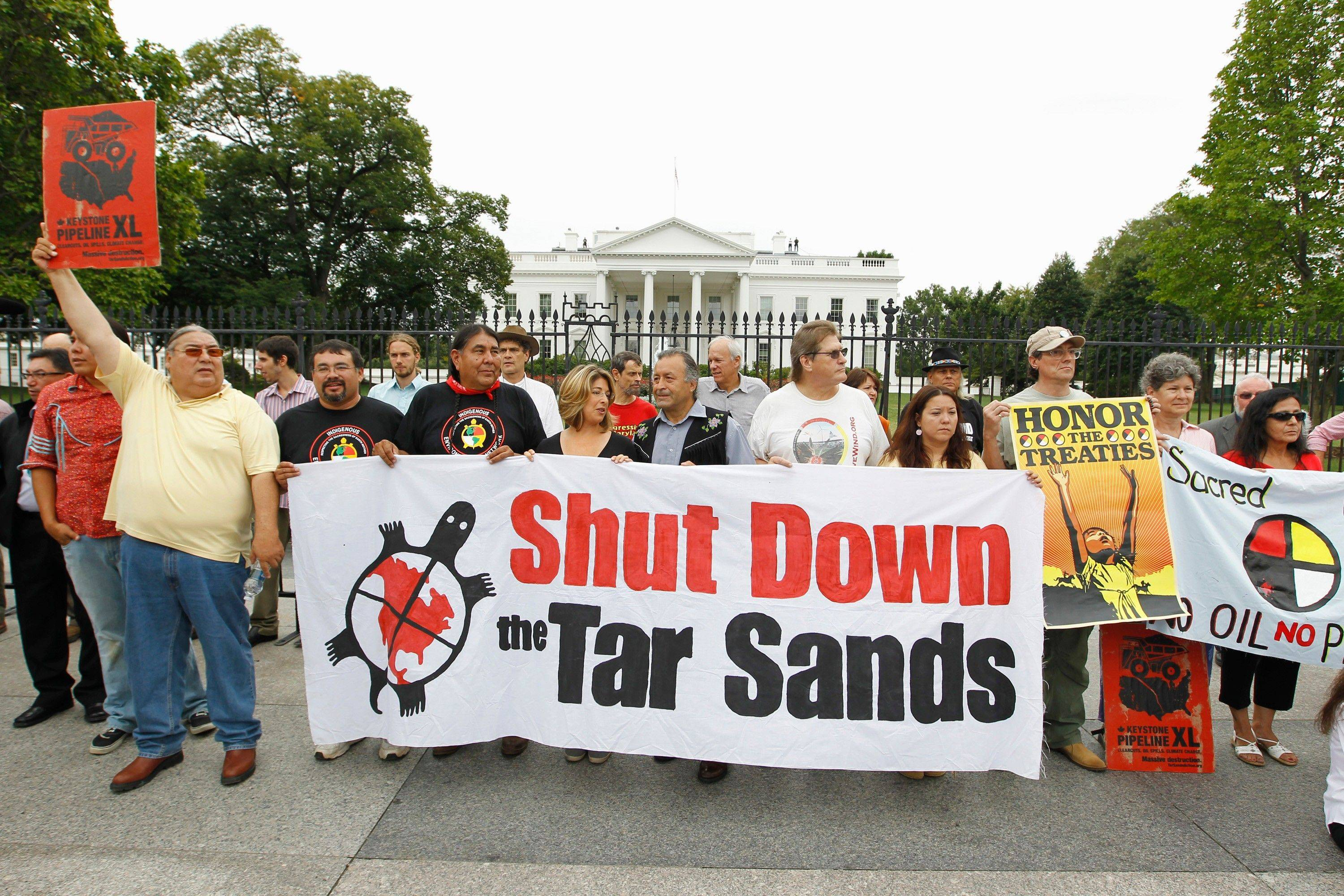 Demonstrators protest the Keystone XL Pipeline project in front of the White House in Washington on Sept. 2. The high-profile anti-pipeline campaign included repeated arrests of activists outside the White House.
