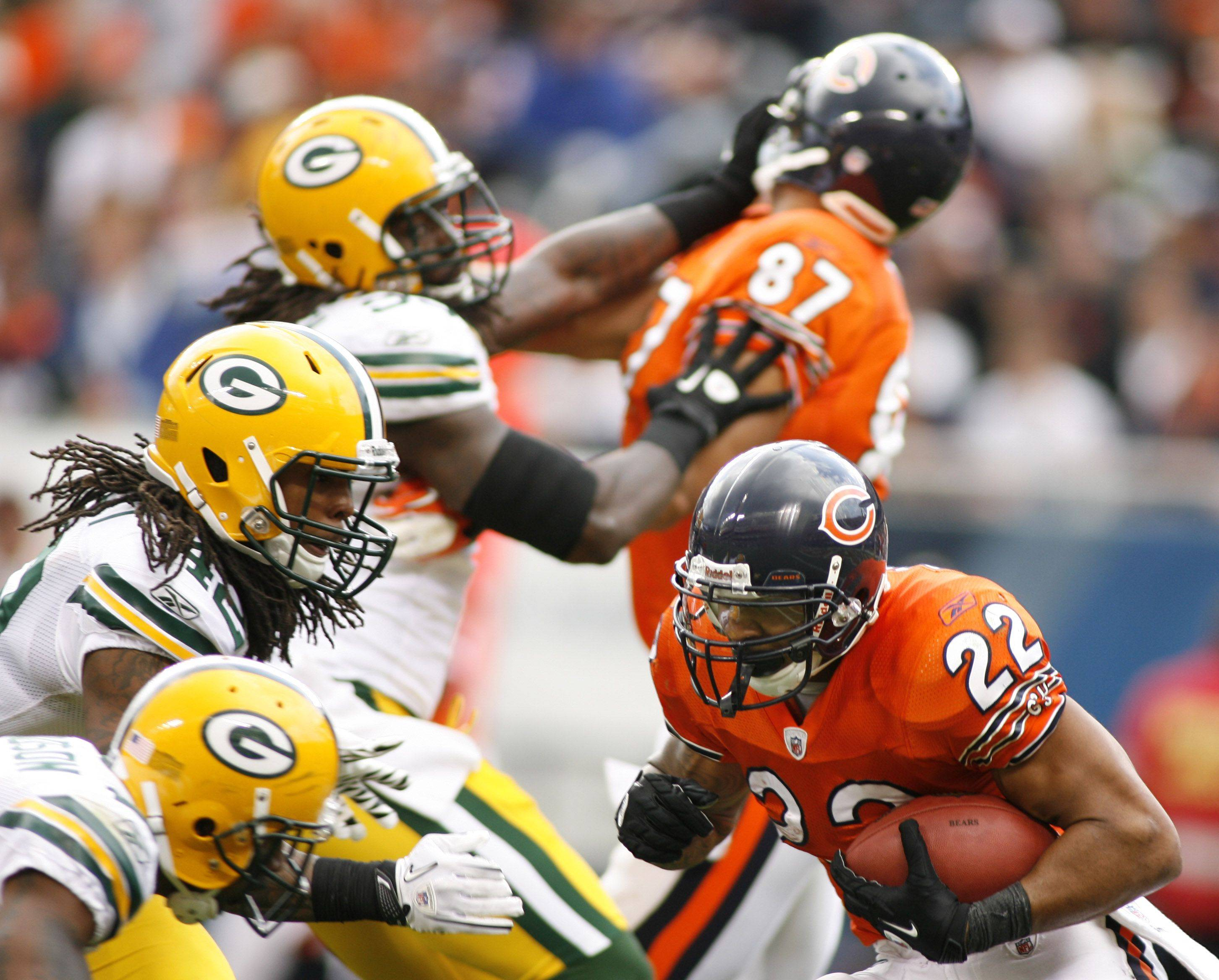 A wall of Packers cuts off running back Matt Forte during the second half Sunday in the 27-17 Bears loss at Soldier Field.