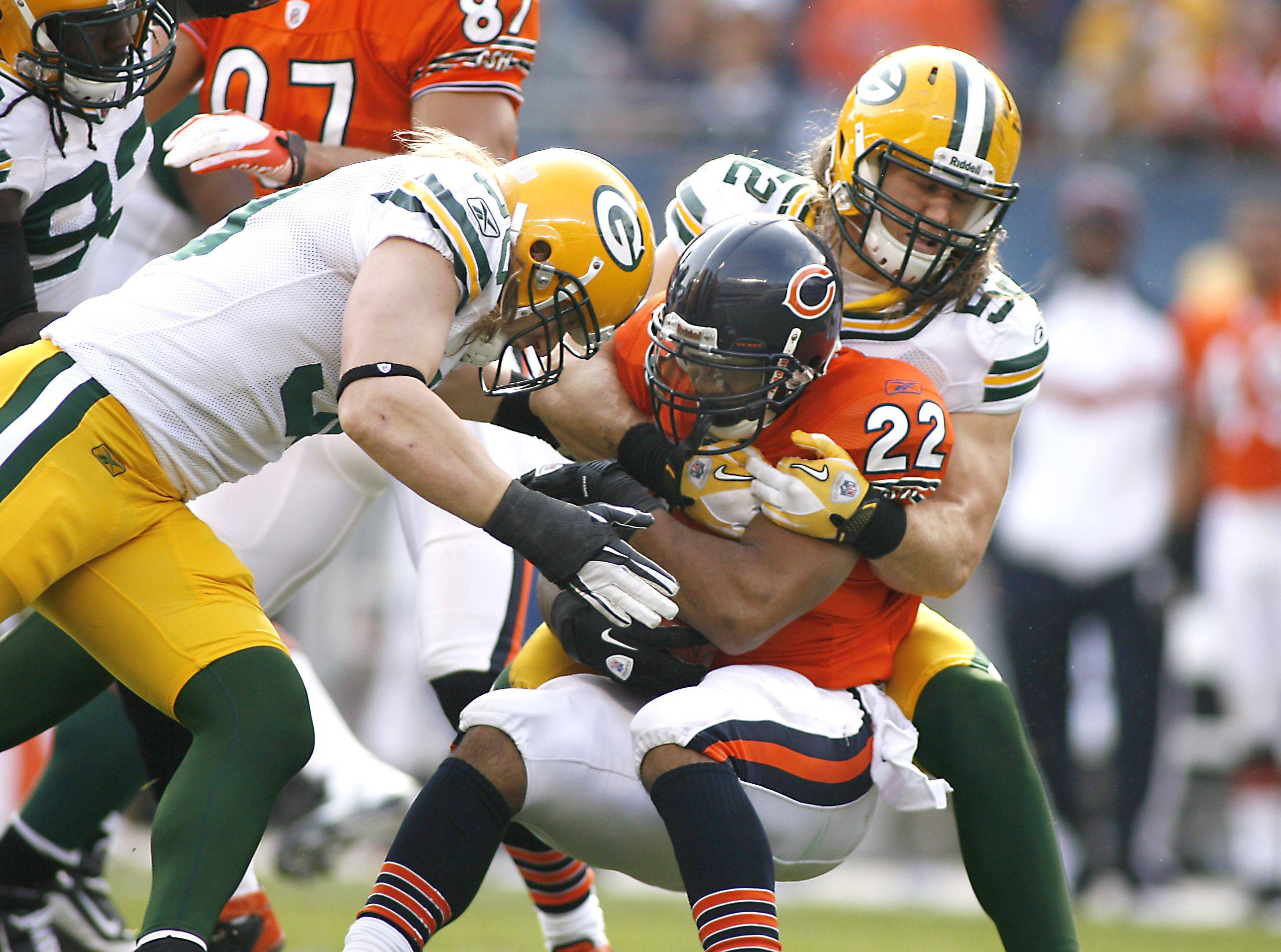 The Bears' Matt Forte gets dropped for a loss in the backfield by A.J. Hawk and Clay Matthews during the first half of the Green Bay Packers' 27-17 win over the Chicago Bears.