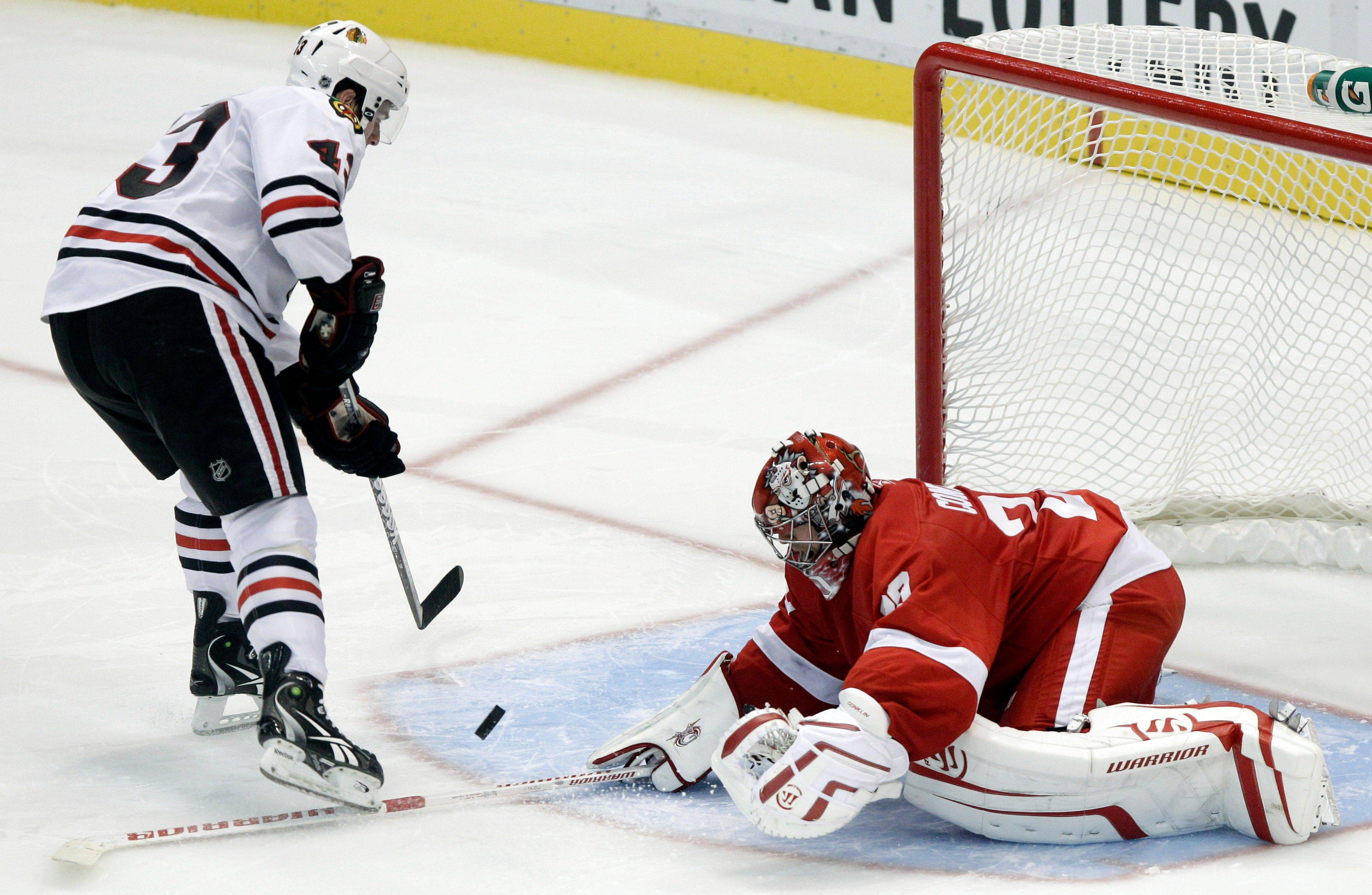 Detroit Red Wings goalie Ty Conklin, right, stops a Chicago Blackhawks� Brandon Saad shot in a shootout during an NHL preseason hockey game on Sunday, Sept. 25, 2011, in Detroit. Detroit won 4-3 in a shootout.