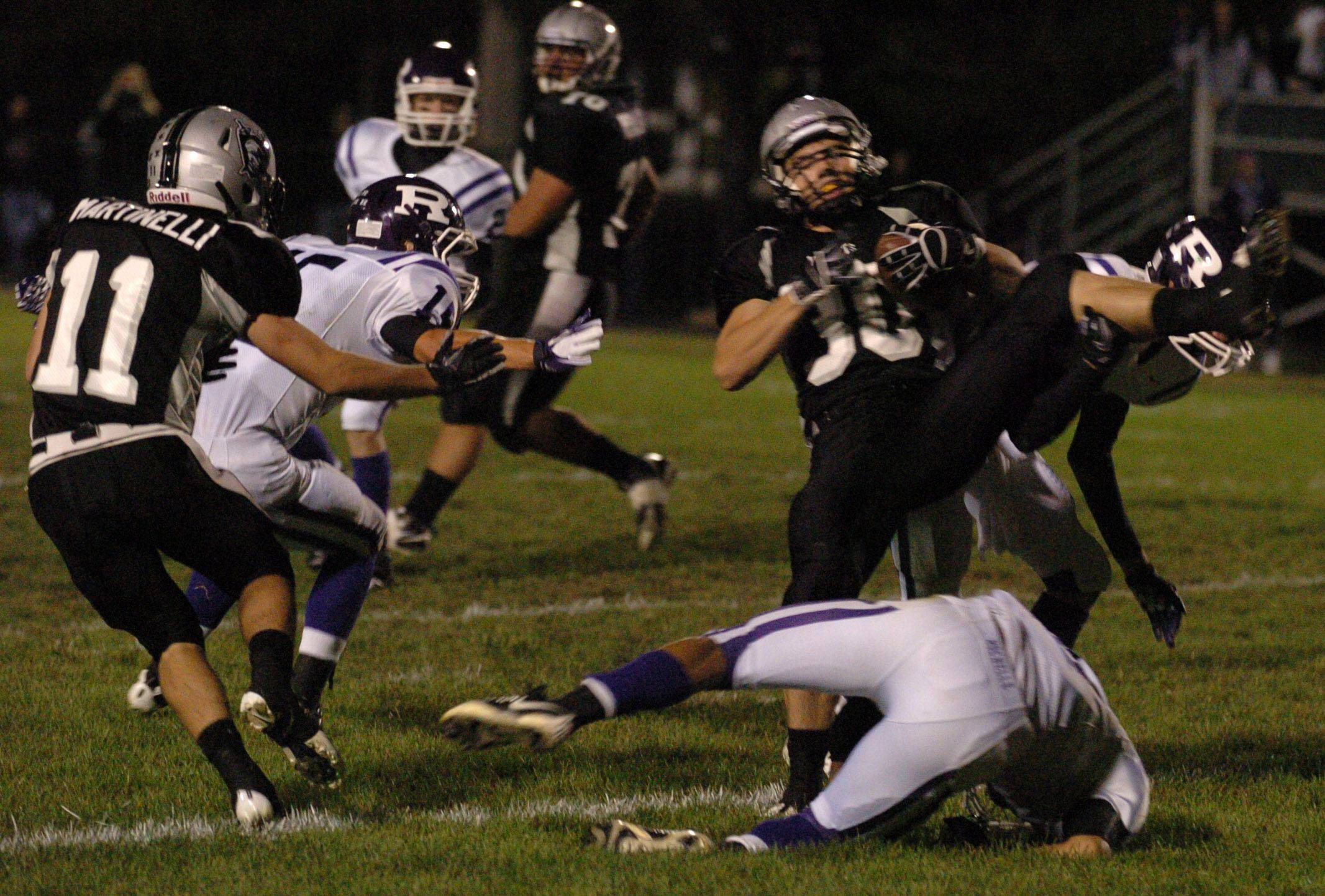 Kaneland�s Jesse Balluff runs the ball through the Rochelle defense Friday at Kaneland High School.