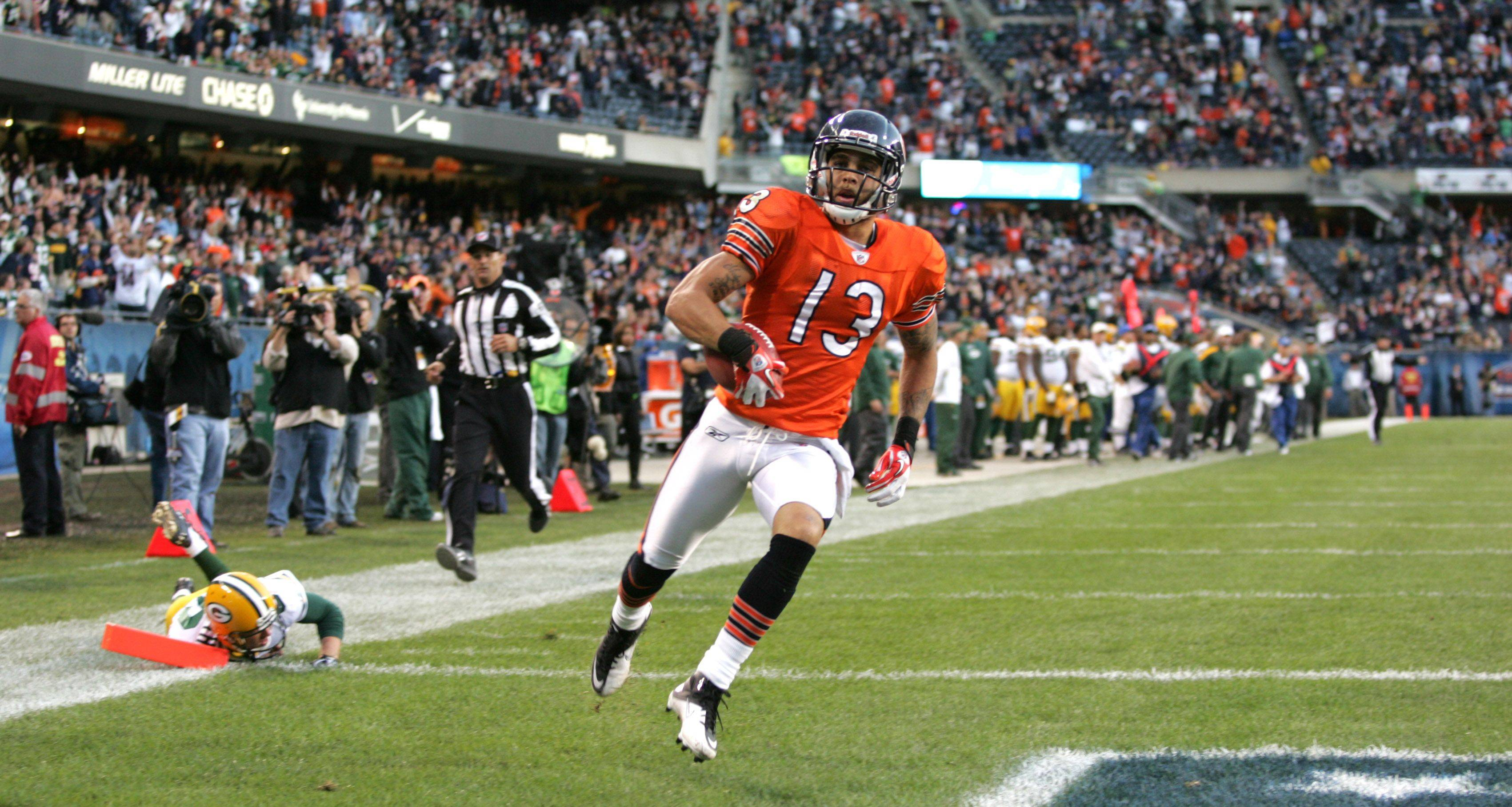 Johnny Knox returns a punt for a touchdown that was called back on a holding penalty late in Sunday's loss to the Packers.