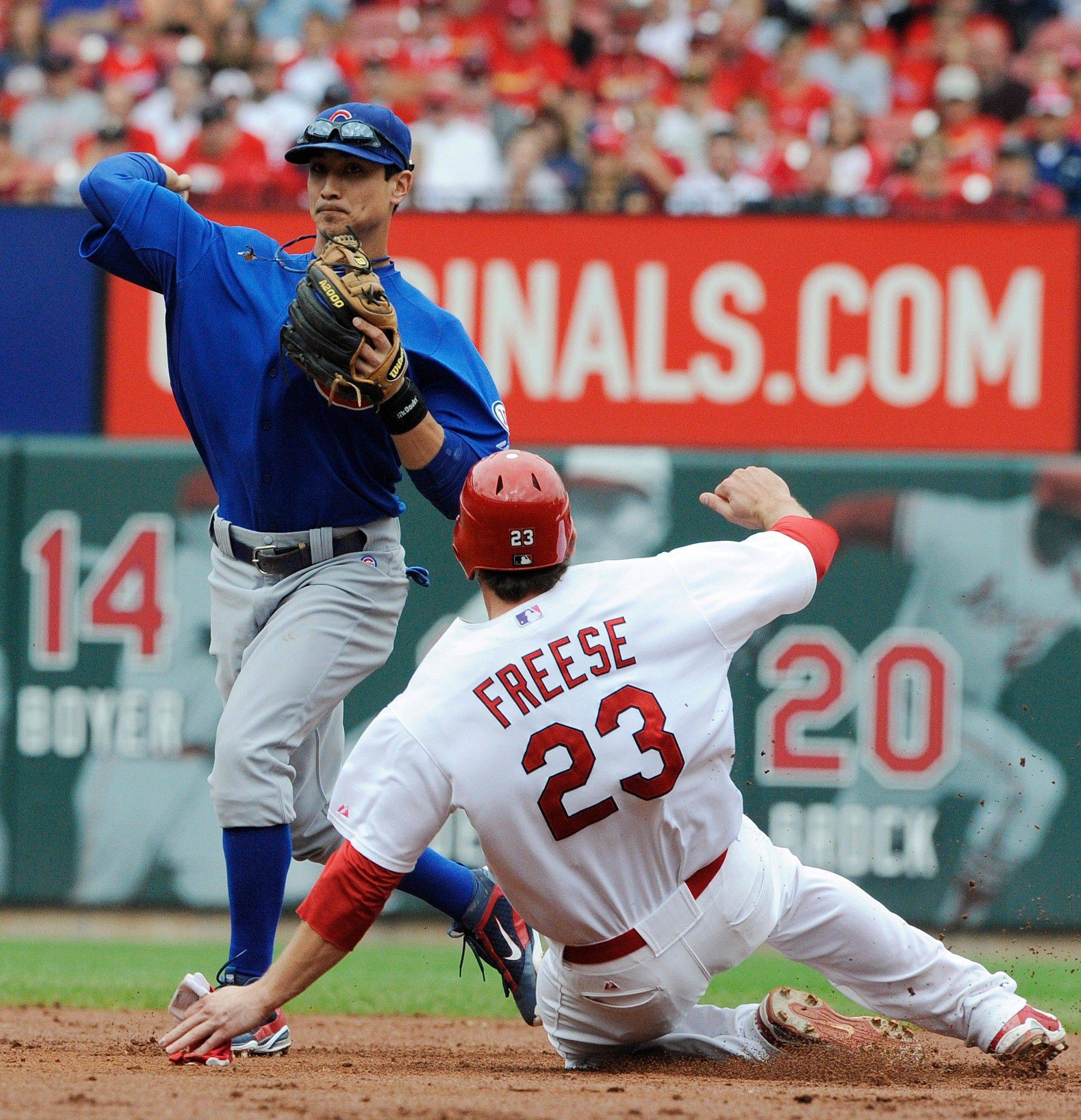 The St. Louis Cardinals� David Freese is forced out at second as the Cubs� Darwin Barney, left, completes the double play in Sunday�s second inning in St. Louis.