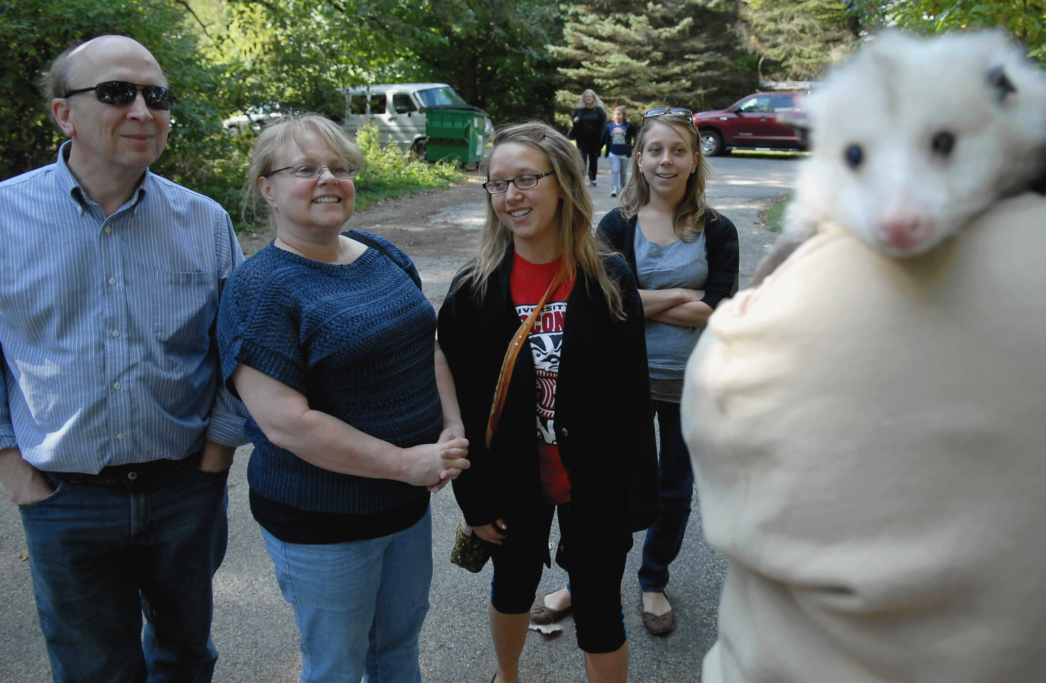 From left to right, Don Becker, Pam Becker, Laura Becker, 17, and Amy Becker look at a possum during an open house Sunday at the Fox Valley Wildlife Center in Elburn. Laura Becker, who volunteers once a week at the center, brought her family to the open house.