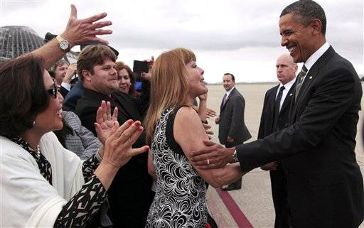 President Barack Obama stops to greet people on the tarmac during his arrival at Moffett Airfield, near San Jose, Calif., Sunday.