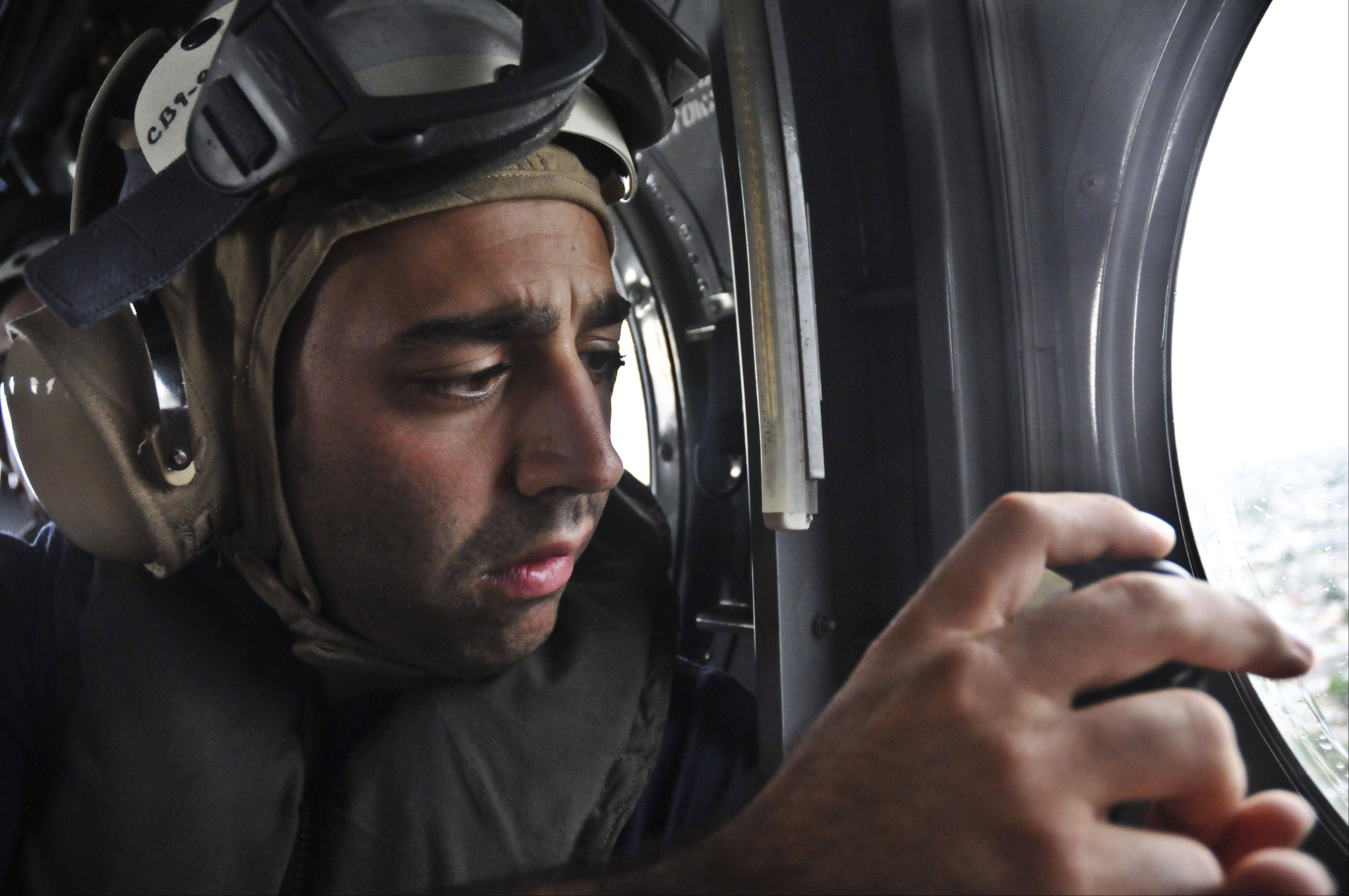 This close up of Pasquale Iannino, president and creative director of Rockit Projects Inc. was taken in a dual rotor CH-46E Sea Knight helicopter, which was taken to shore every day during the Promise Mission in 2010.