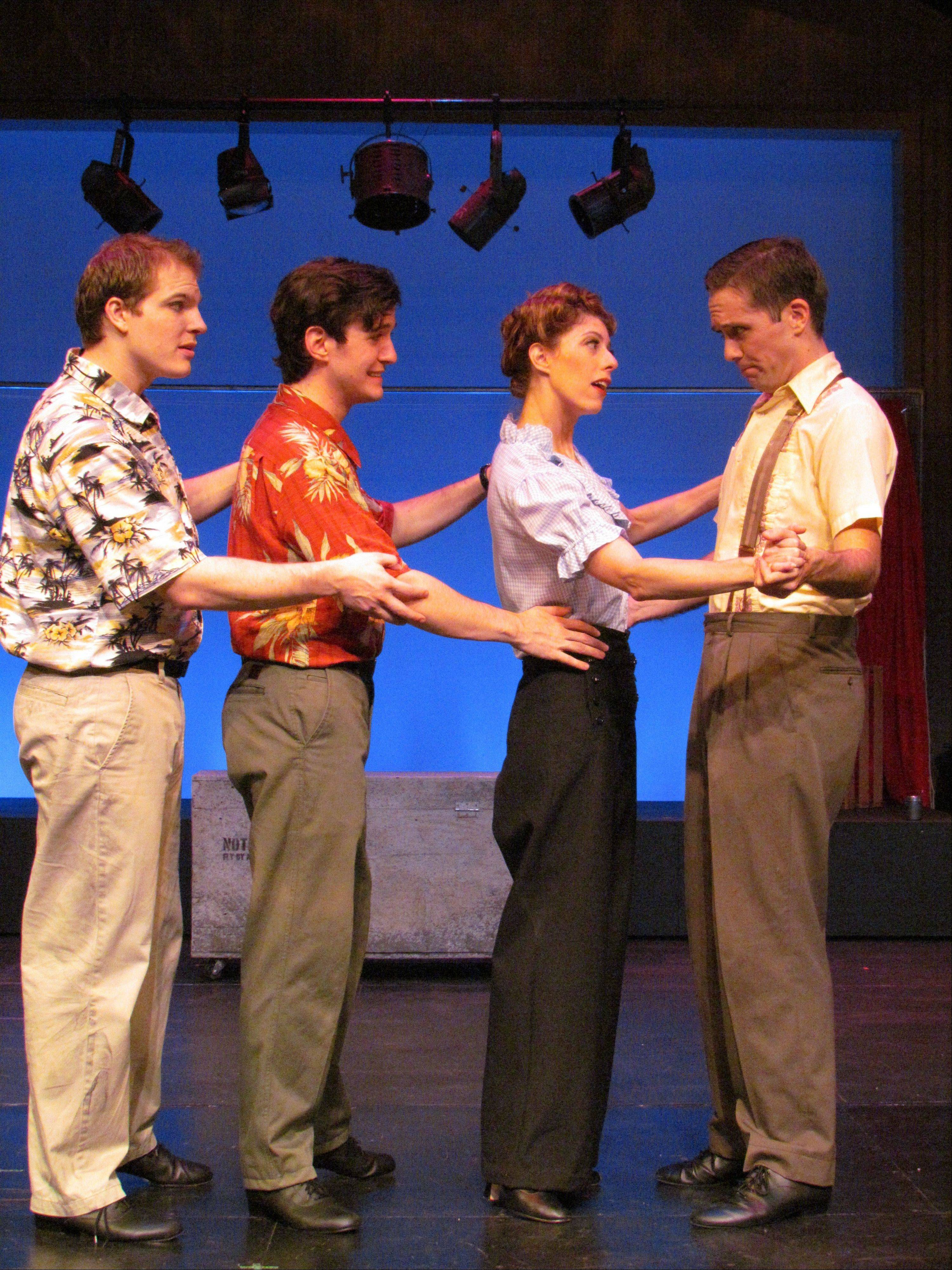 "Lawrence Andrews (James Nedrud), Max Andrews (Matt Edmonds) and Patrick Andrews (Patrick Tierney, far right) dance in rehearsal with pinup model Peggy Jones (Lauren Creel) in ""The Andrews Brothers"" at the Metropolis Performing Arts Centre in Arlington Heights."