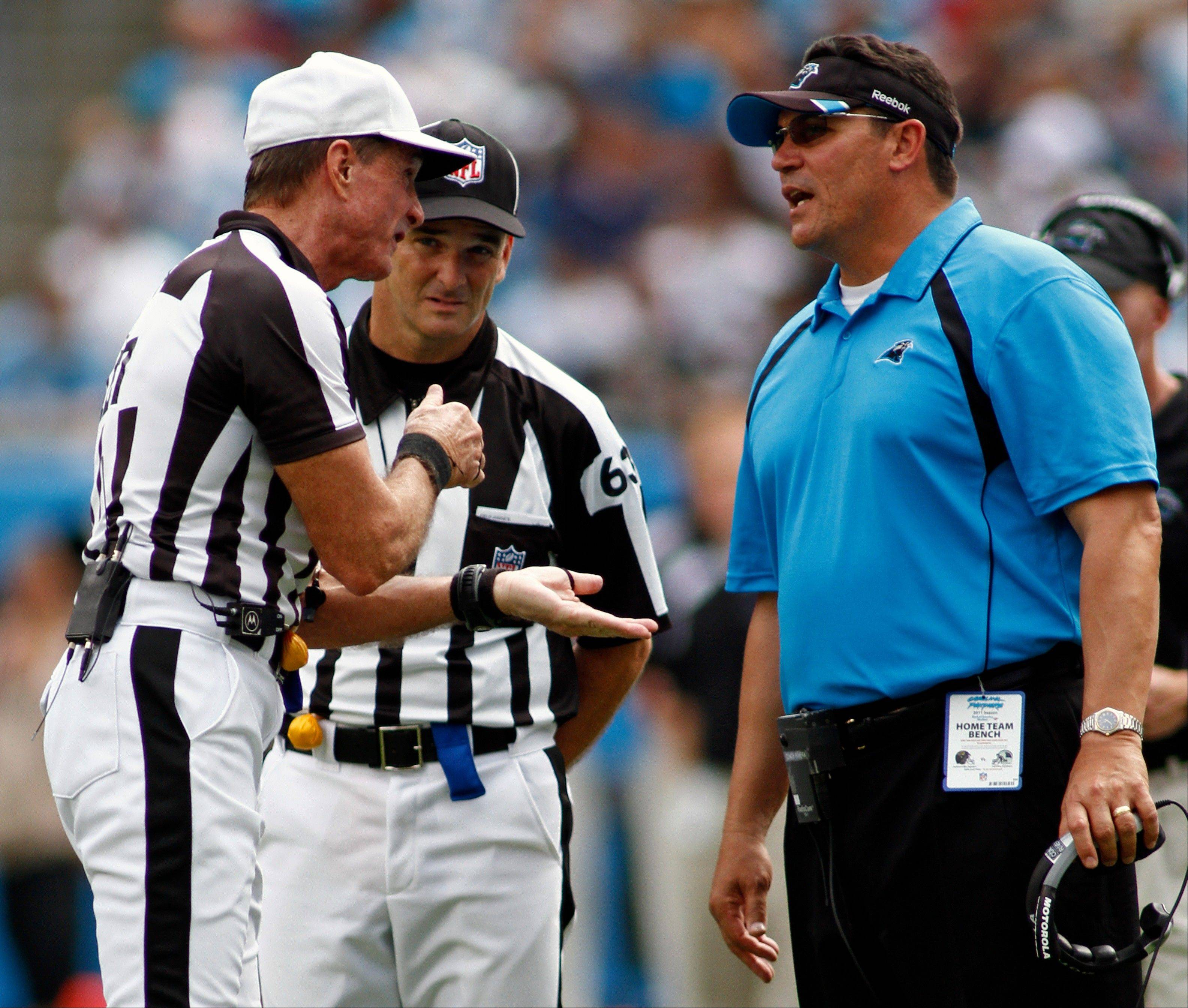 Carolina Panthers head coach Ron Rivera argues a call with referee Bill Leavy during Sunday�s victory over Jacksonville.