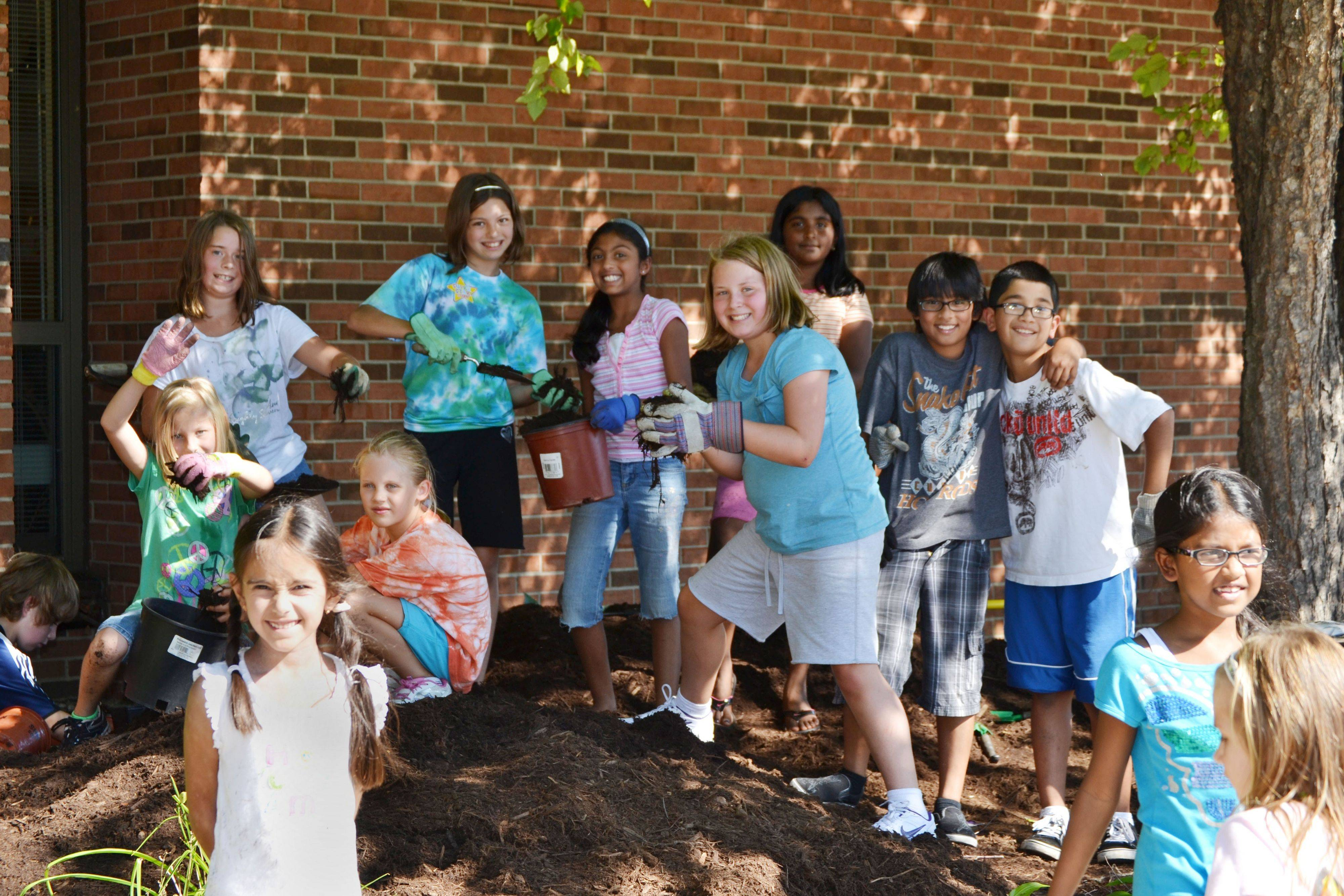 Students at the Hoover Math and Science Academy gathered with parents and community members last month to plant $4,000 worth of donations from Lowe's in Schaumburg before it closed its doors.