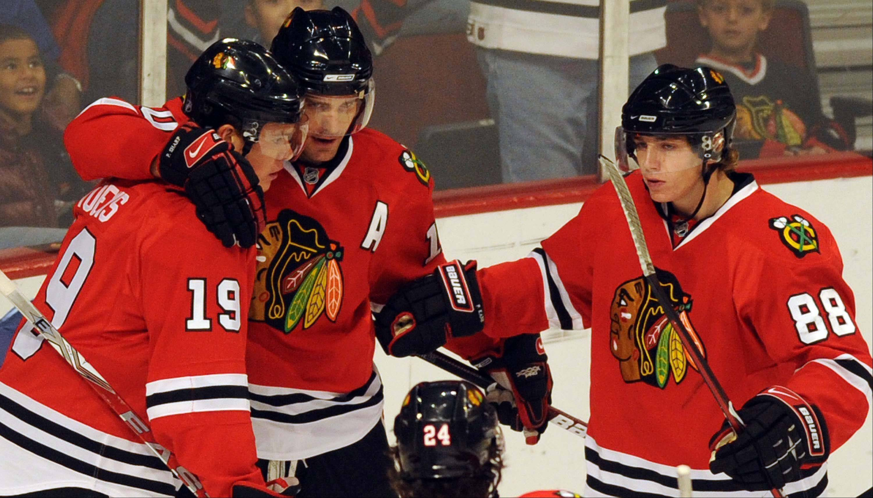 Patrick Kane, far right with Jonathan Toews (19) and Patrick Sharp, possibly could be switching to center for the Blackhawks.