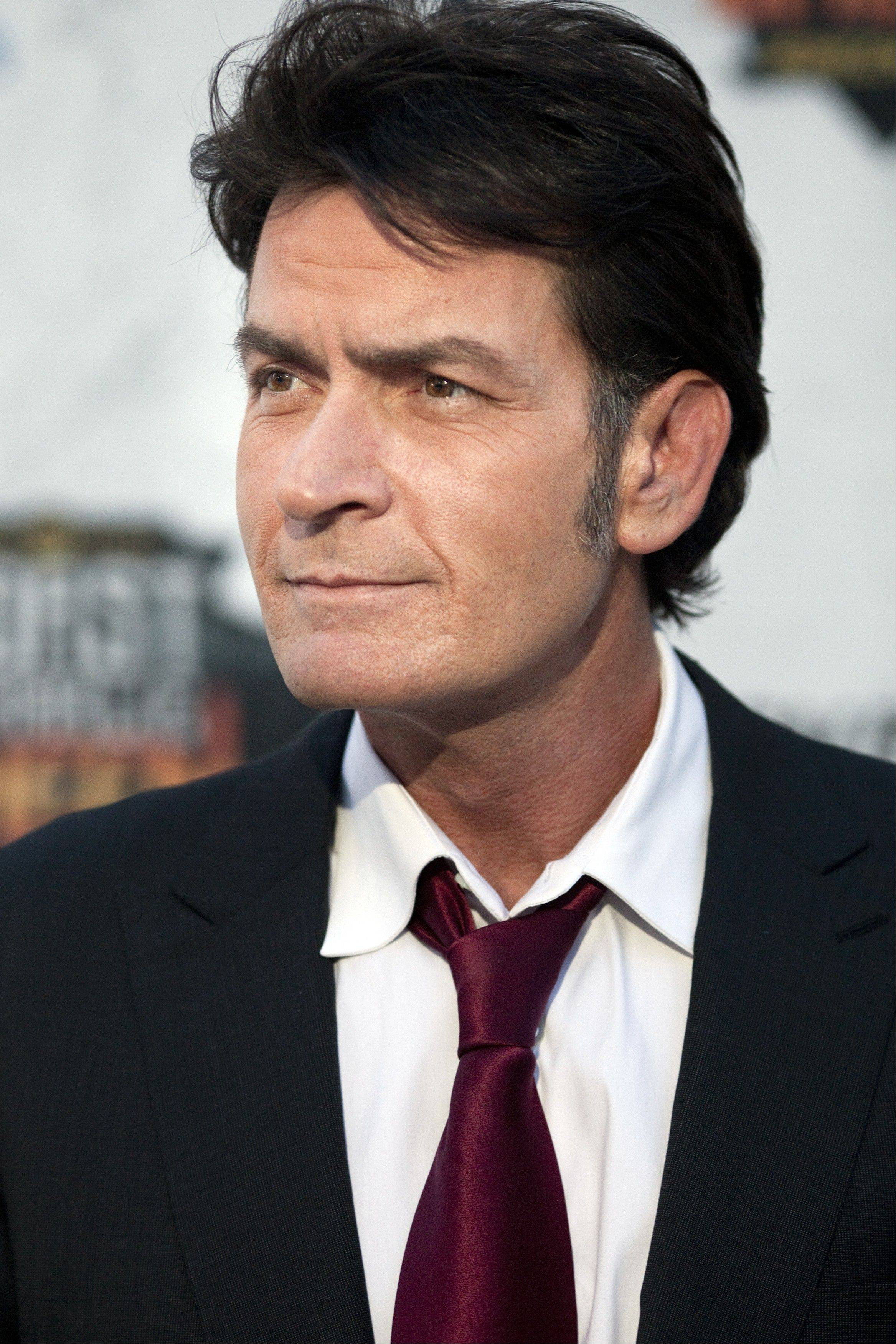 "Warner Bros. Television released a statement on Monday saying that Charlie Sheen's lawsuit against the studio and series executive producer Chuck Lorre had been settled ""to the parties' satisfaction."""