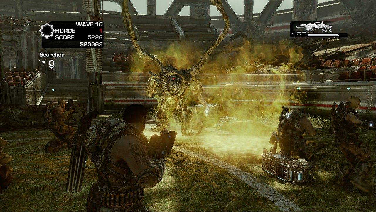 "Soldiers battle a berserker in the Horde mode of the game ""Gears of War 3."""