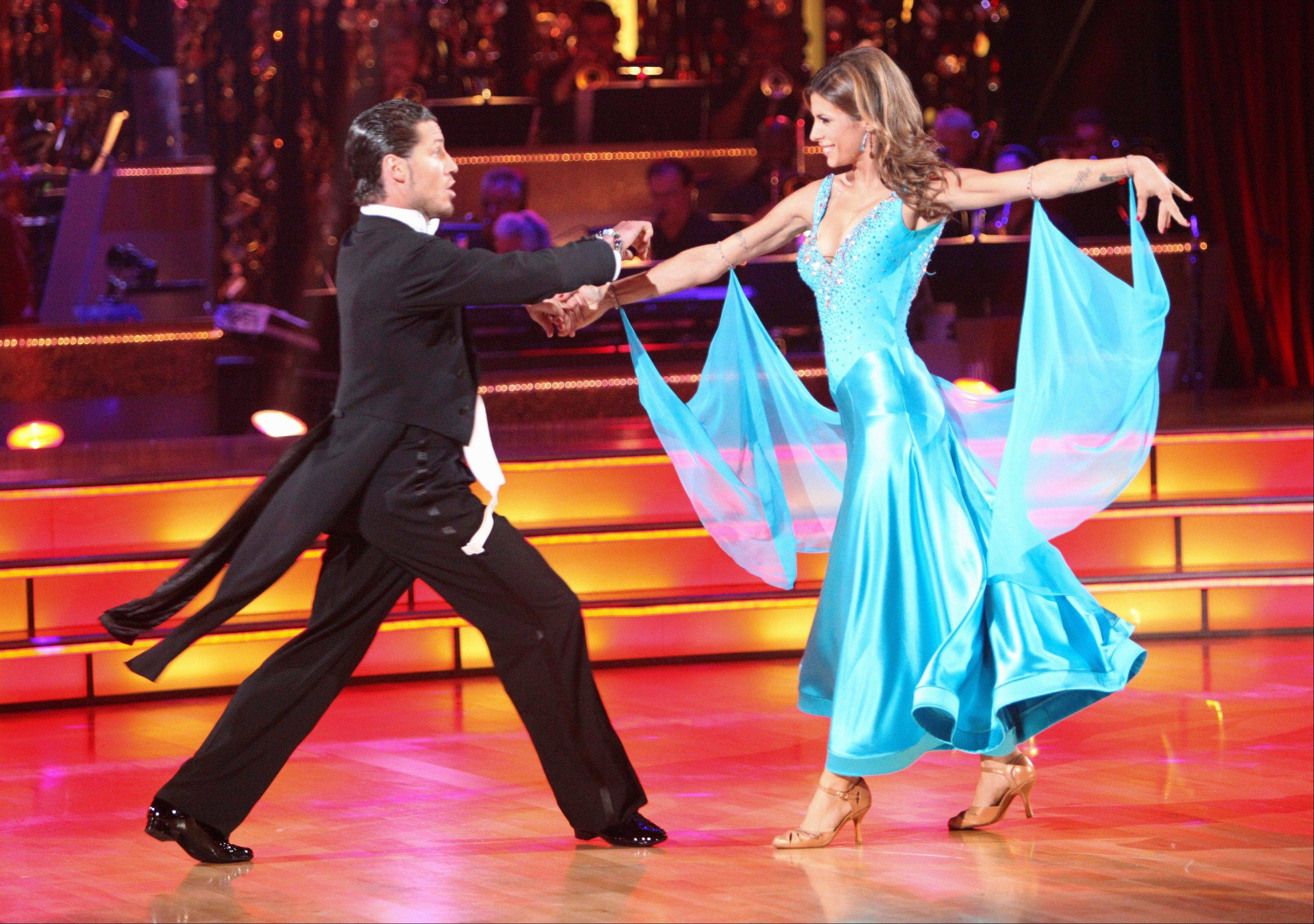 "Elisabetta Canalis, right, and her partner Val Chmerkovskiy were eliminated from ""Dancing With the Stars"" Tuesday night even though they scored high marks with the judges with a lively quickstep on Monday night."