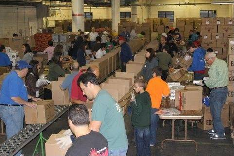 Hundreds of volunteers help pack and deliver thousands of food boxes for needy Jews in the Chicago area for Rosh Hashana, which starts at sundown today. $START_URL$Maot Chitim staged the event at an empty warehouse in Niles.;http://www.maotchitim.org/$STOP_URL$