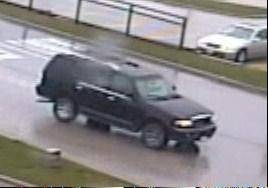 A surveillance photo of a black Lincoln Navigator leaving the scene of an armed robbery in Antioch late Tuesday morning.