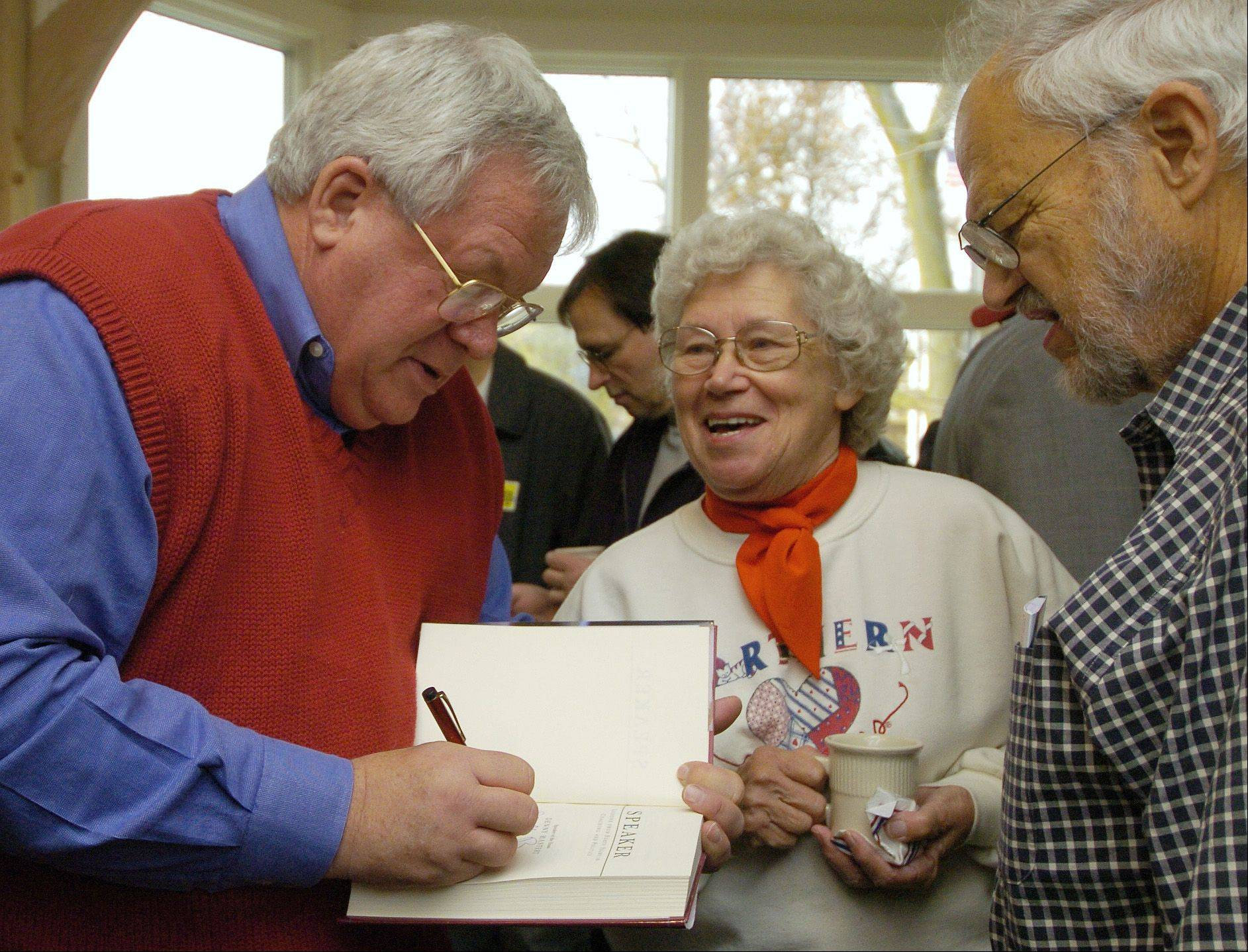 Fred Doederlein, right, and his wife, DeLoris, get an autographed copy of a book by former U.S. Speaker Dennis Hastert at a 2006 election rally in Geneva.