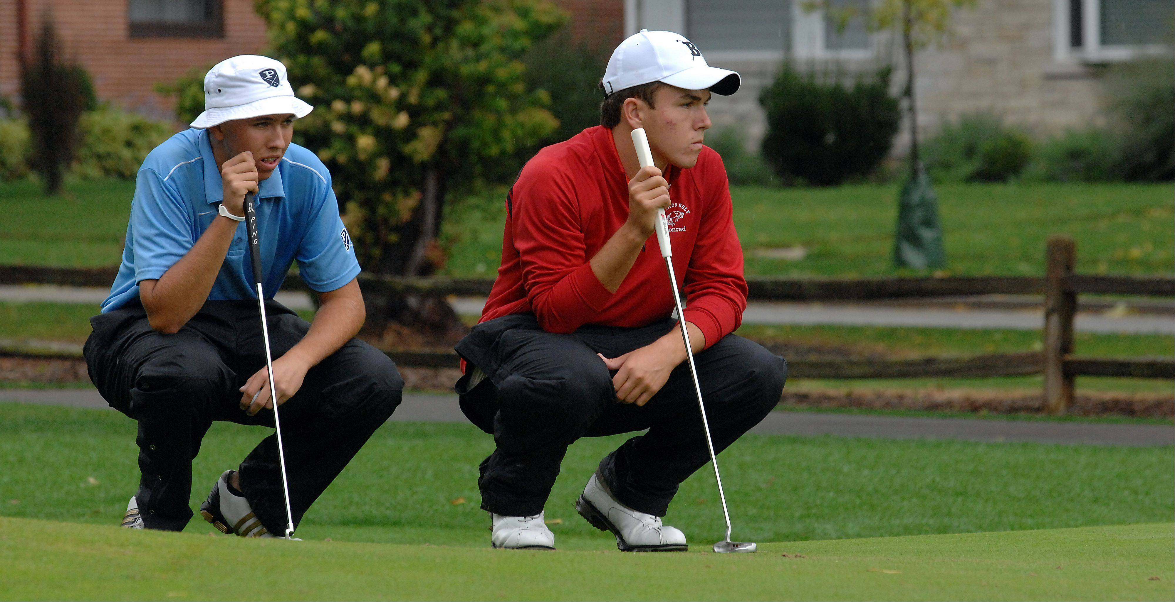 Barrington's Greg Conrad, right, and Prospect's Ryan Kowalski tried to read their putts at No. 9 on Mt. Prospect Golf Course during the Mid-Suburban League tournament on Tuesday.