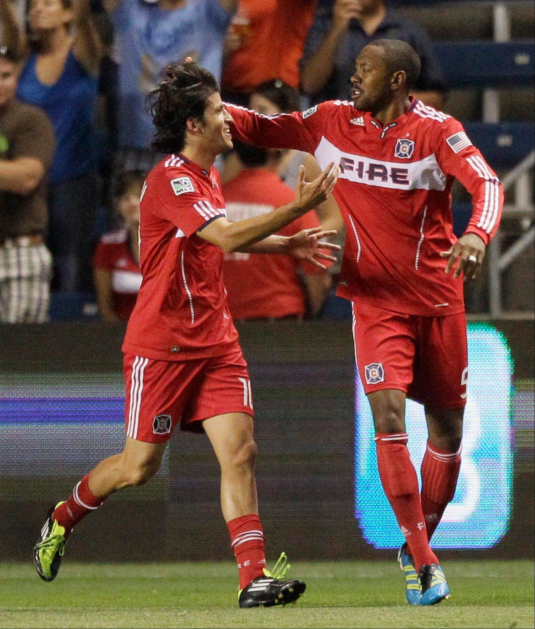 The Fire's Cory Gibbs, right, celebrates with Sebastian Grazzini after scoring a goal during the first half against the Colorado Rapids on Saturday. Grazzini has been one of the Fire's plesant surprises this season although he arrived too late to make much of a difference.