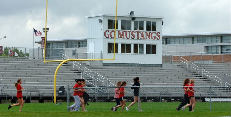 The Mundelein High School District 120 board will choose a manufacturer for an artificial turf football field tonight. The work -- along with the construction of a new running track around the field -- is expected to cost $1.9 million.