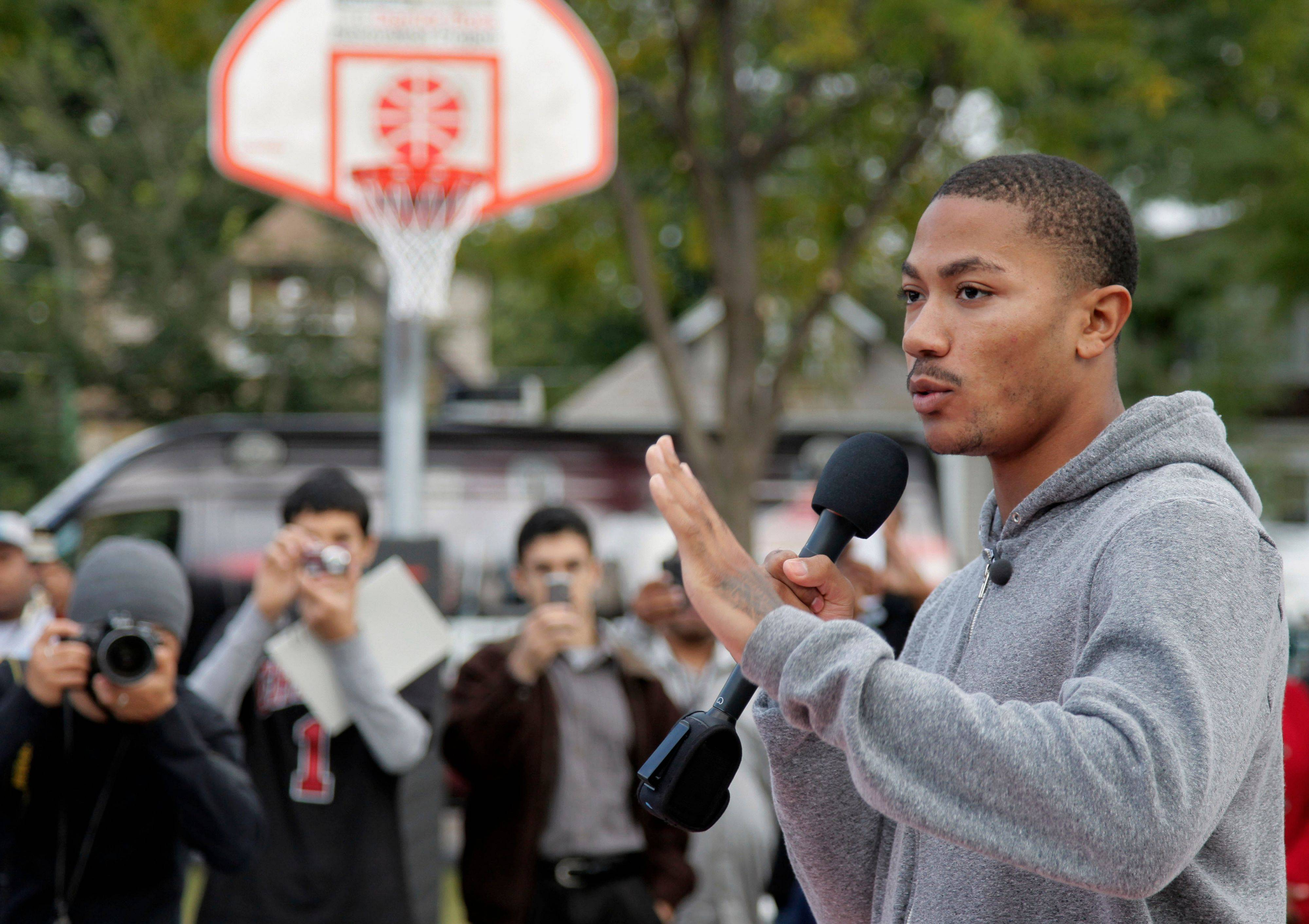The Bulls' Derrick Rose talks Tuesday as he participates with dozens of elementary school students from his alma mater, Randolph Elementary School on Chicago's South Side.