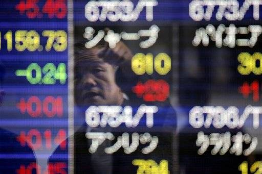 Man points at the electronic stock board of a securities firm in Tokyo, Japan, Tuesday. Asian stocks rebounded Tuesday as pledges by European officials to resolve the region's debt problems.