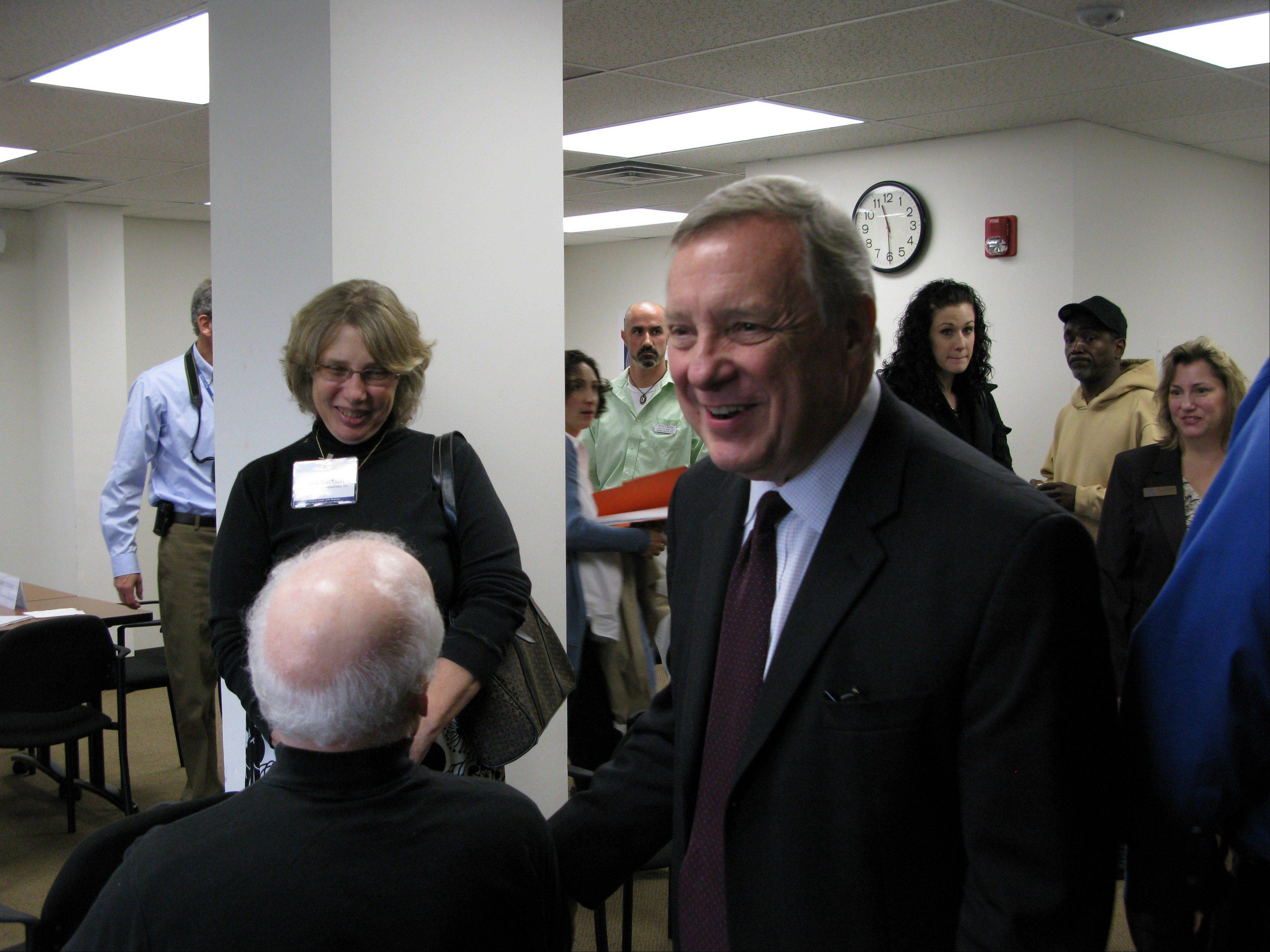 Sen. Dick Durbin championed President Barack Obama�s jobs bill Wednesday in Aurora while also bending an ear to Kane County human service agencies struggling from the loss of federal grants.