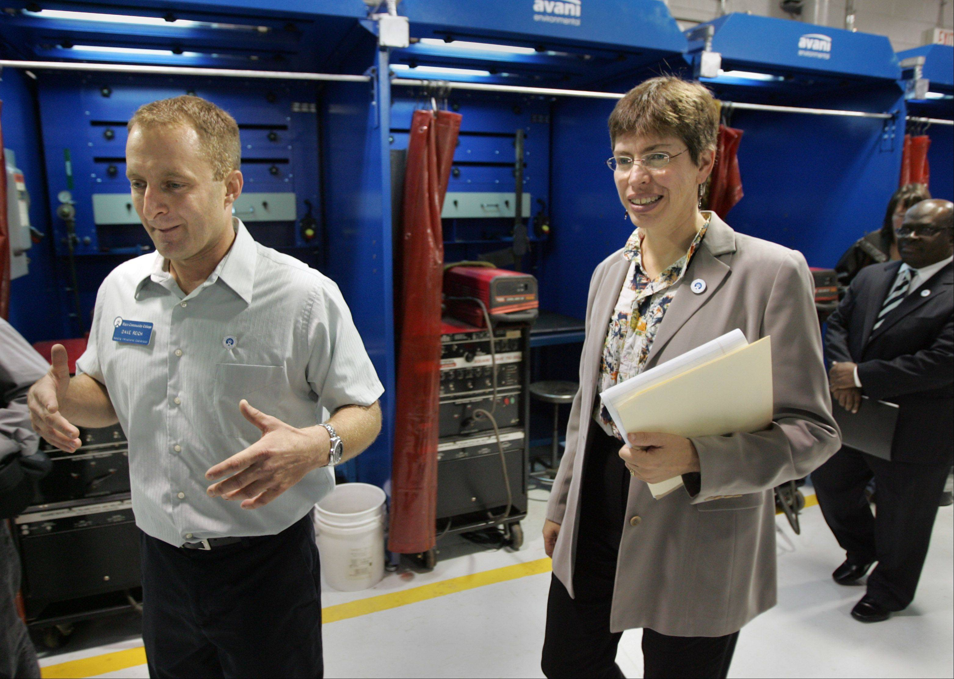 Lt. Gov. Sheila Simon is taken on a tour of the welding lab Wednesday by instructional coordinator Dave Reich at Elgin Community College.