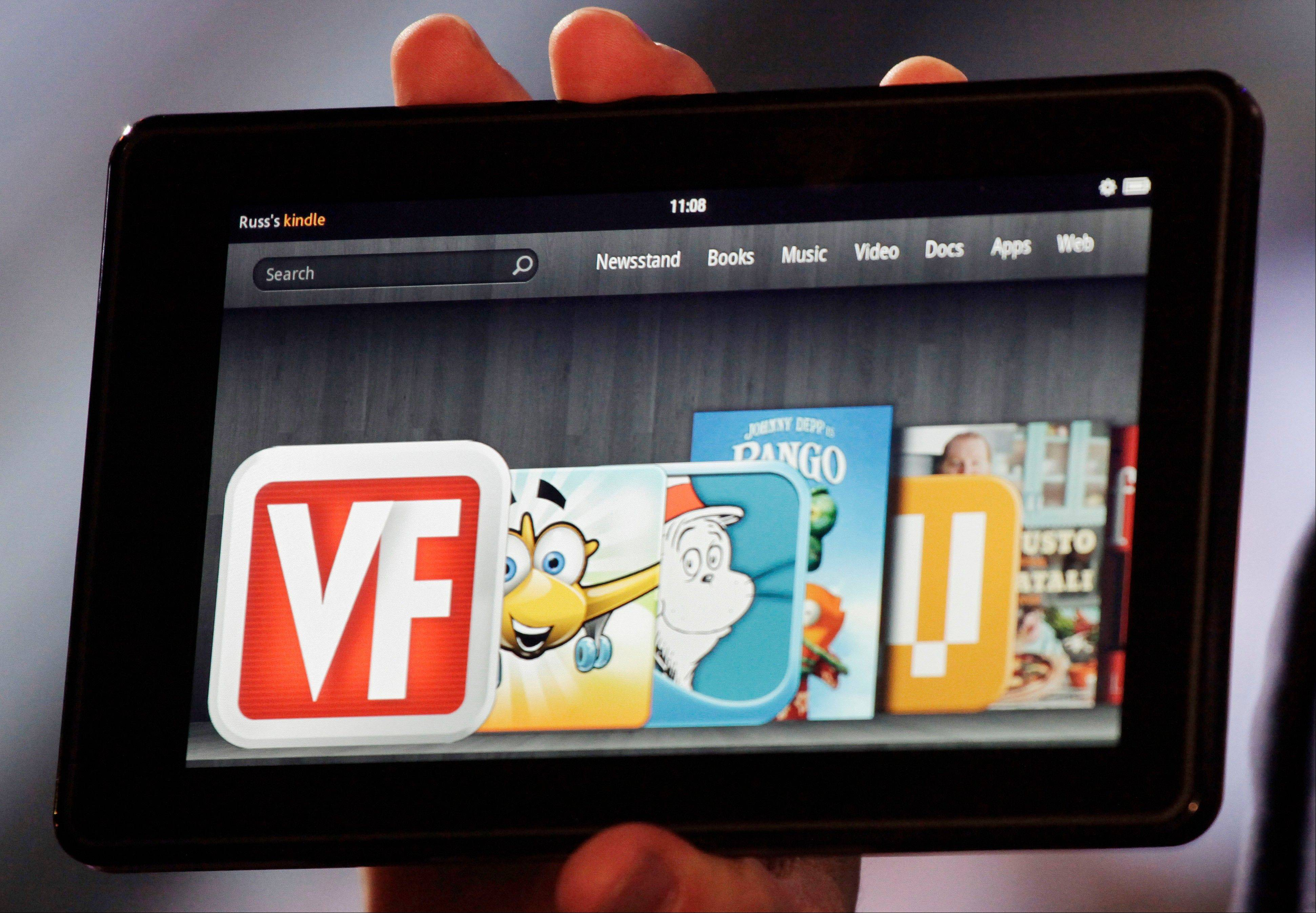 The Kindle Fire is shown at a news conference in New York. The e-reader and tablet has a 7-inch (17.78 cm) multicolor touchscreen and will go on sale for $199 on Nov. 15.