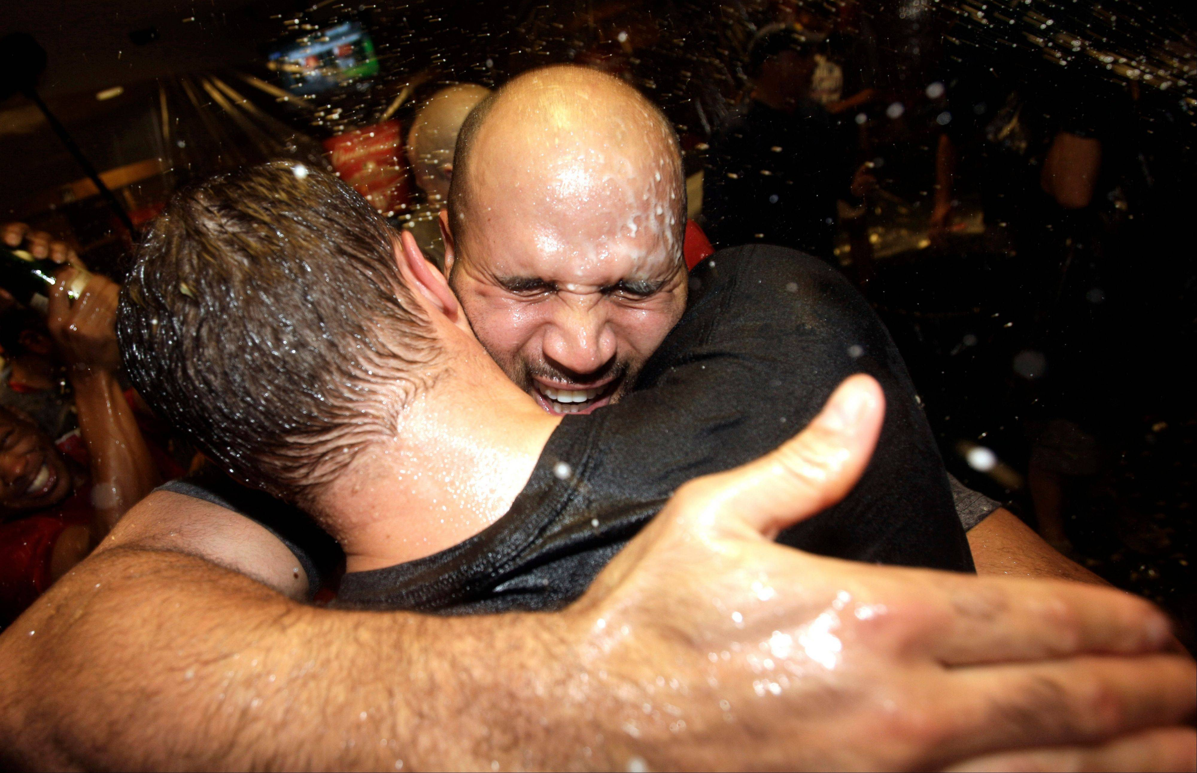 The St. Louis Cardinals� Albert Pujols, right, celebrates Wednesday after the Cardinals clinched the National League wild card.