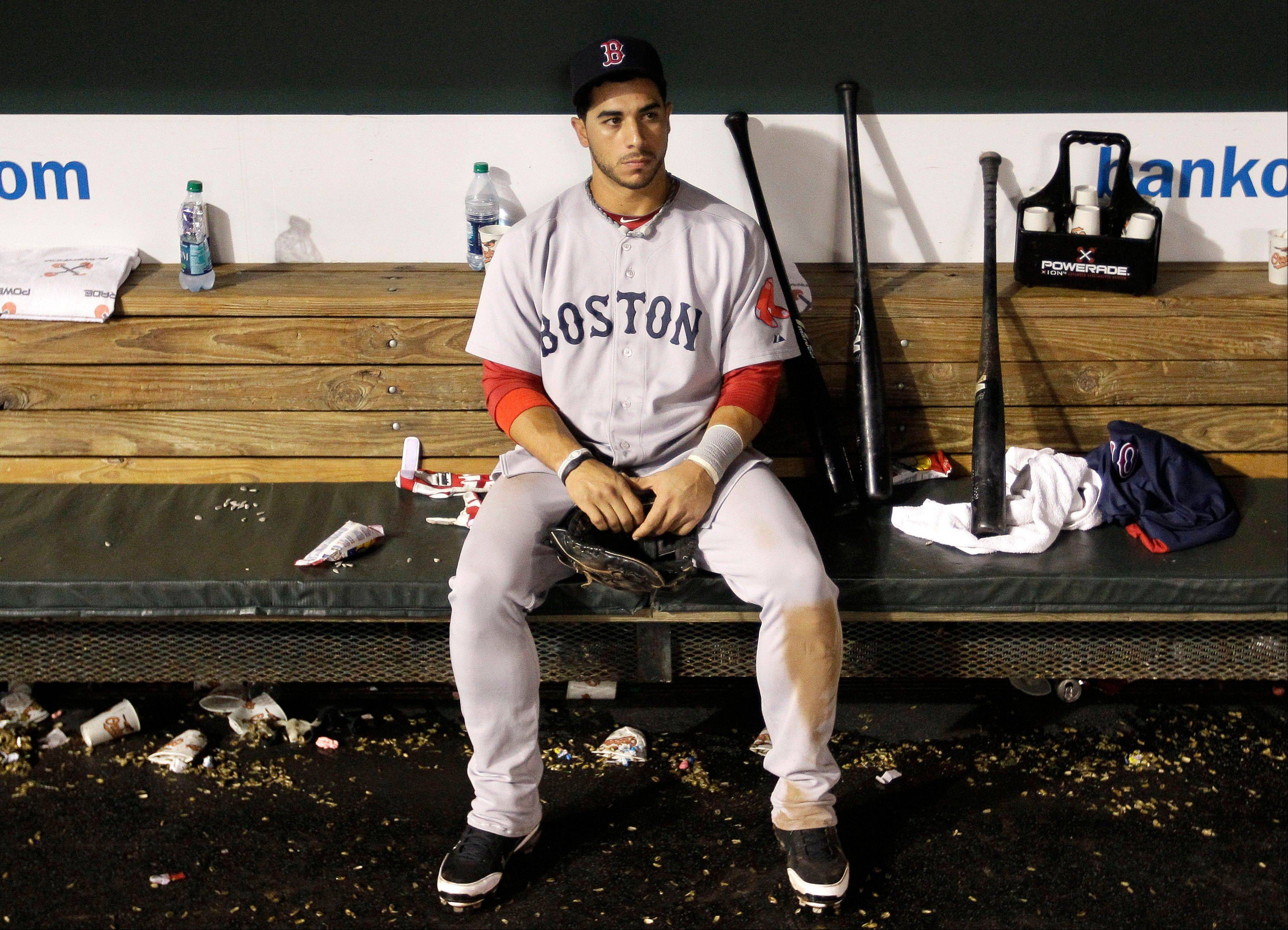 Boston Red Sox third baseman Mike Aviles sits in the dugout after Boston�s 4-3 loss to the Baltimore Orioles Wednesday in Baltimore. Boston was eliminated from the playoffs after the Tampa Bay Rays beat the New York Yankees in extra innings minutes after Boston�s loss.