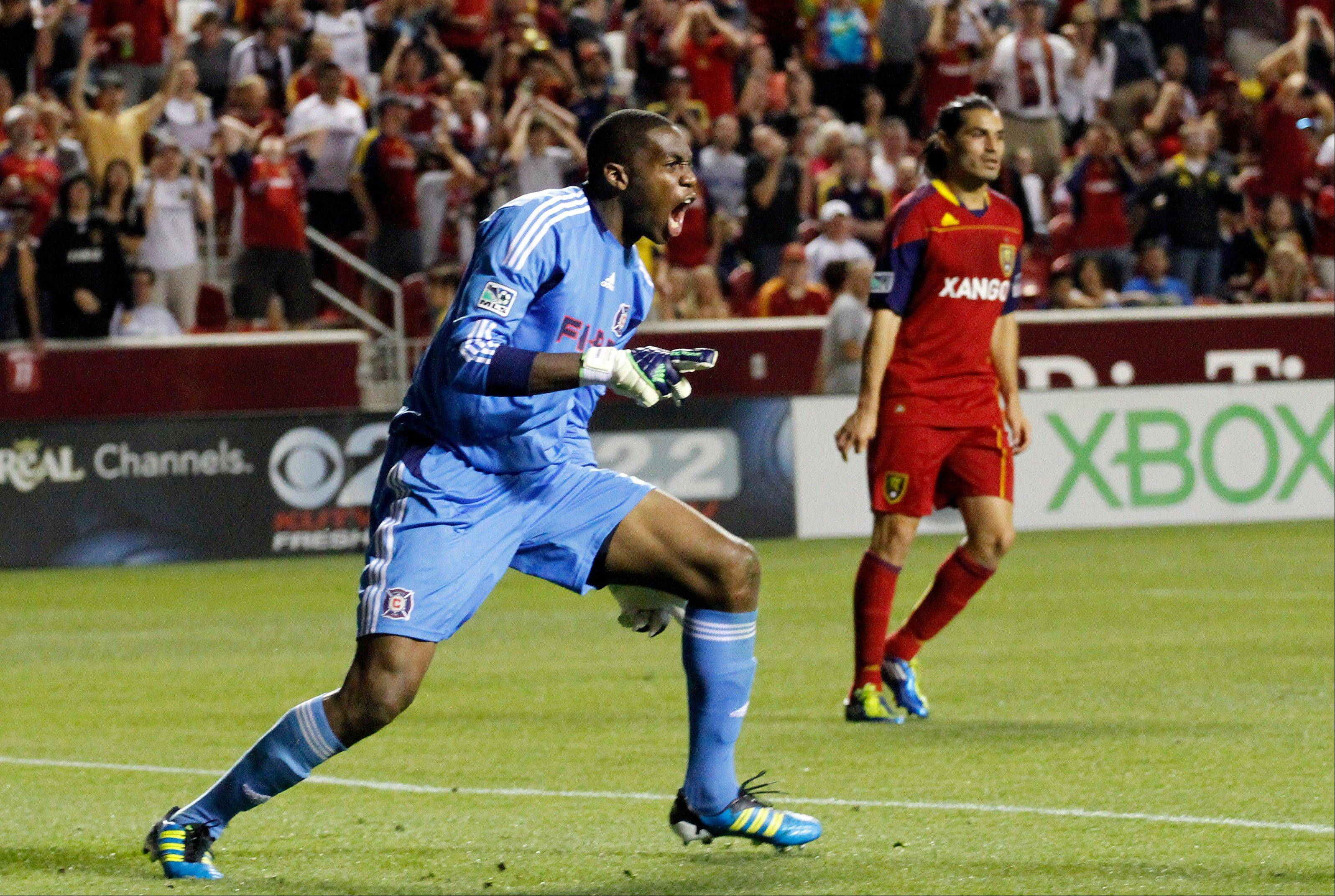 Chicago Fire goalkeeper Sean Johnson (25) reacts after making a save against Real Salt Lake as Real Salt Lake forward Fabian Espindola (7) stands nearby during the first half of an MLS soccer match in Salt Lake City, Wednesday, Sept. 28, 2011. (AP Photo/Jim Urquhart)
