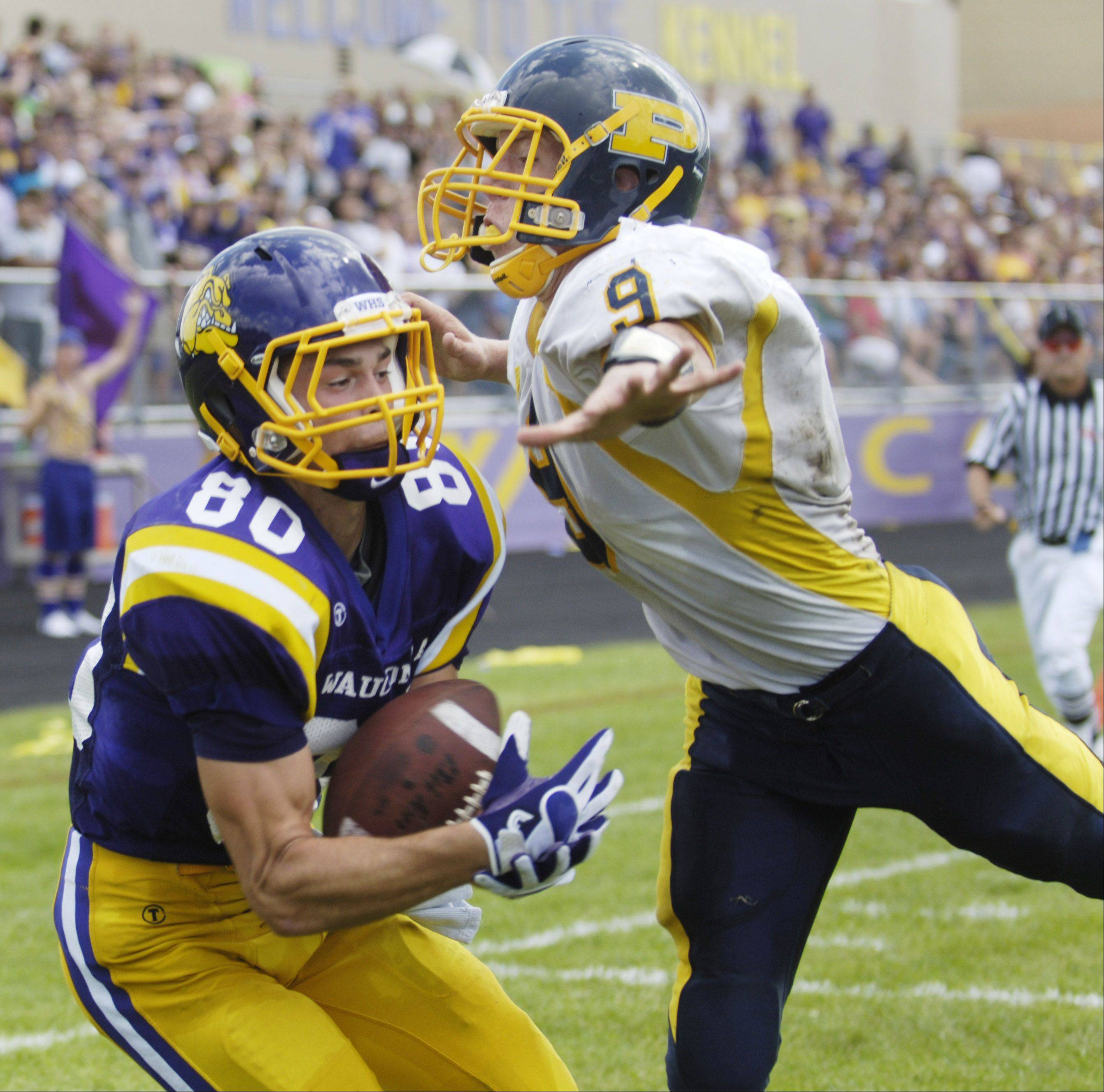 Wauconda�s Jake Ziolkowski catches a touchdown pass in the end zone just past the outstretched hand of Round Lake�s Anthony Burton on Saturday.