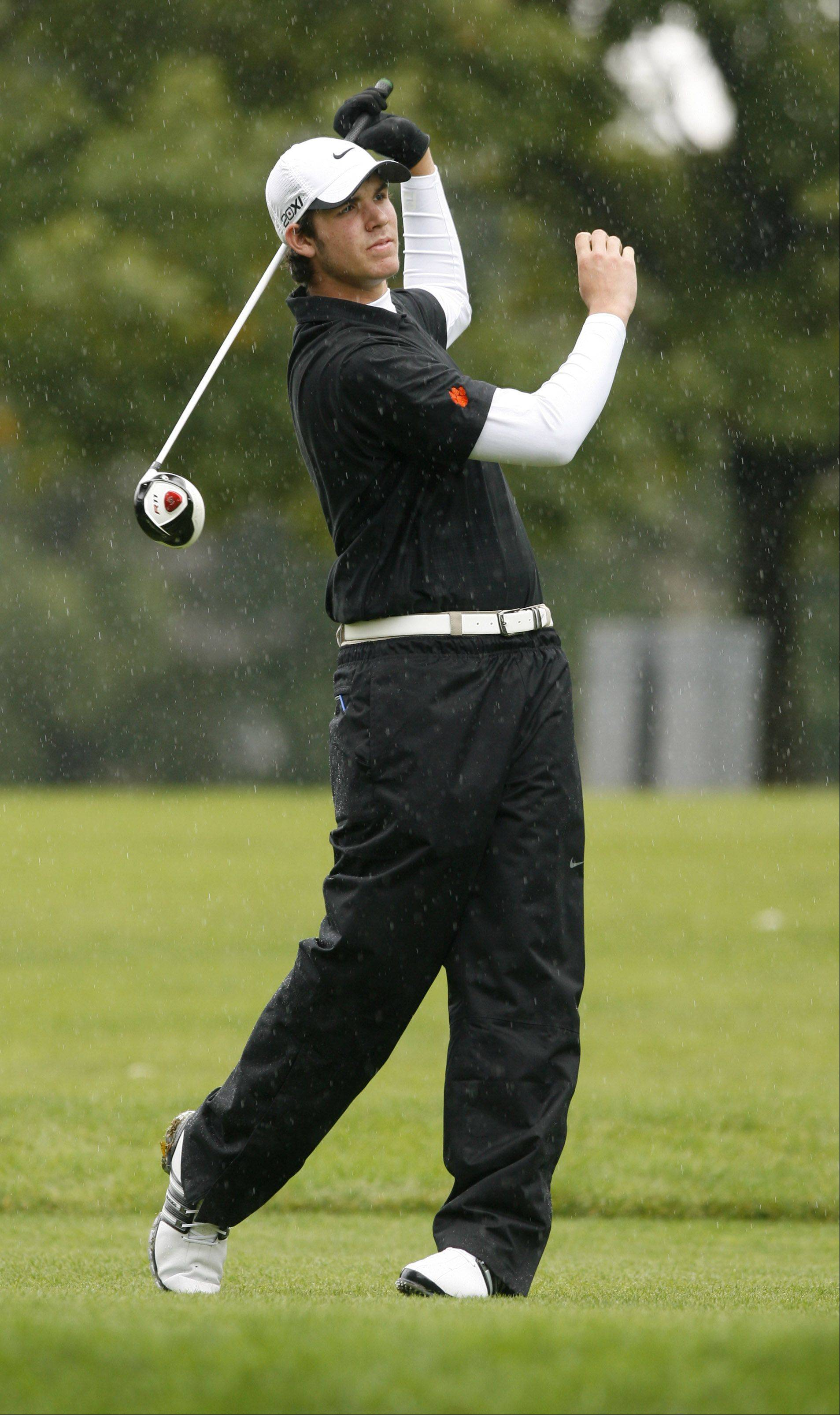 Tee-K Kelly of Wheaton Warrenville South High School tees off during the Boys DuPage Valley Conference tournament at Bartlett Hills Golf Course.