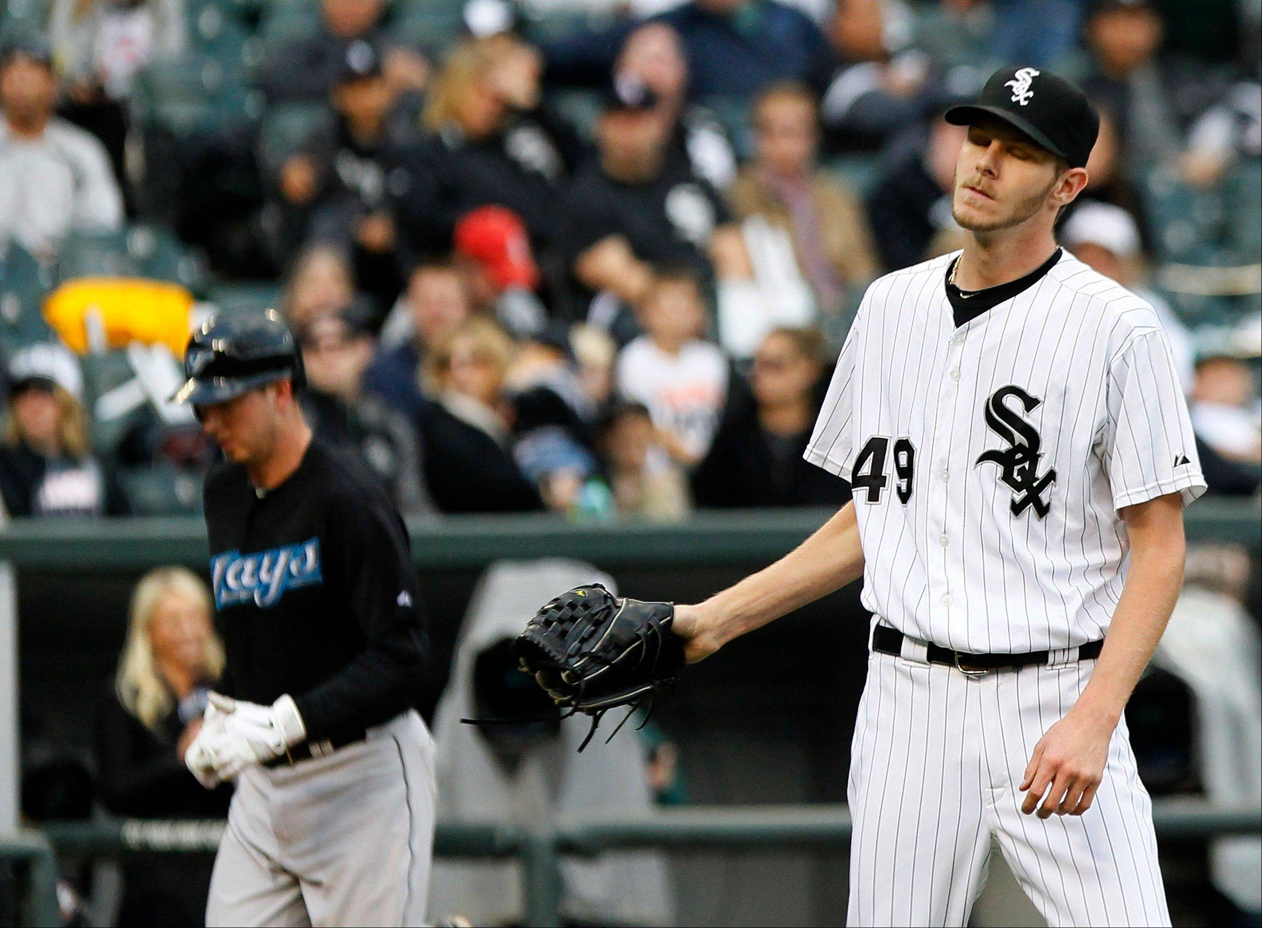 White Sox relief pitcher Chris Sale returns to the mound after walking in the go-ahead run, the Blue Jays' David Cooper, left, during the ninth inning Wednesday.