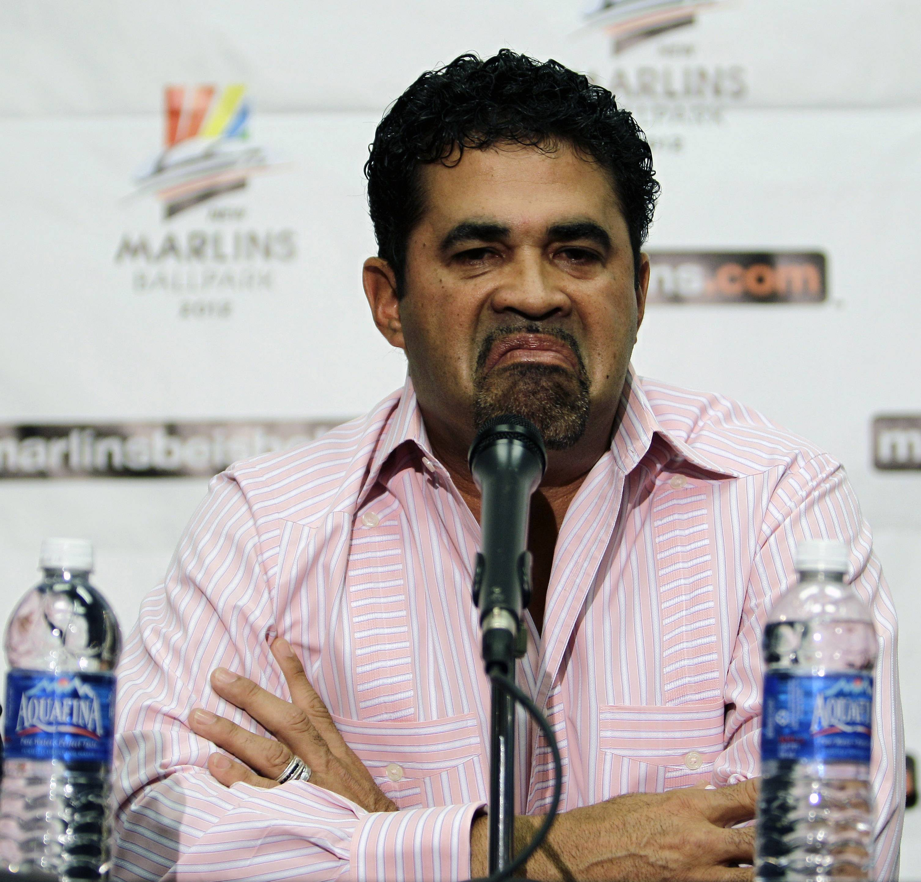Ozzie Guillen reacts Wednesday during a news conference where he was introduced as the new manager of the Florida Marlins.