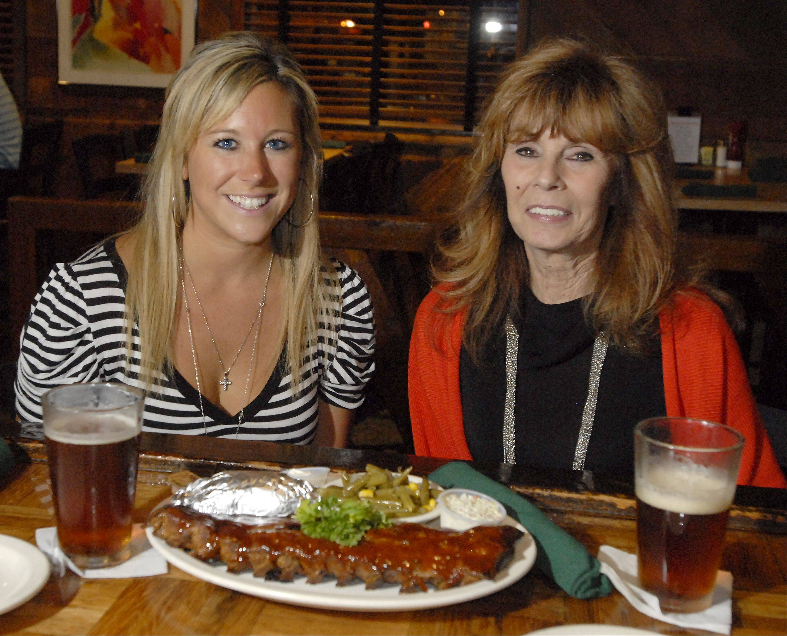 Karri Gibas, left, and her grandmother Carol Gibas, both of Elgin, enjoy a night out at The Assembly American Bar & Café in Hoffman Estates.