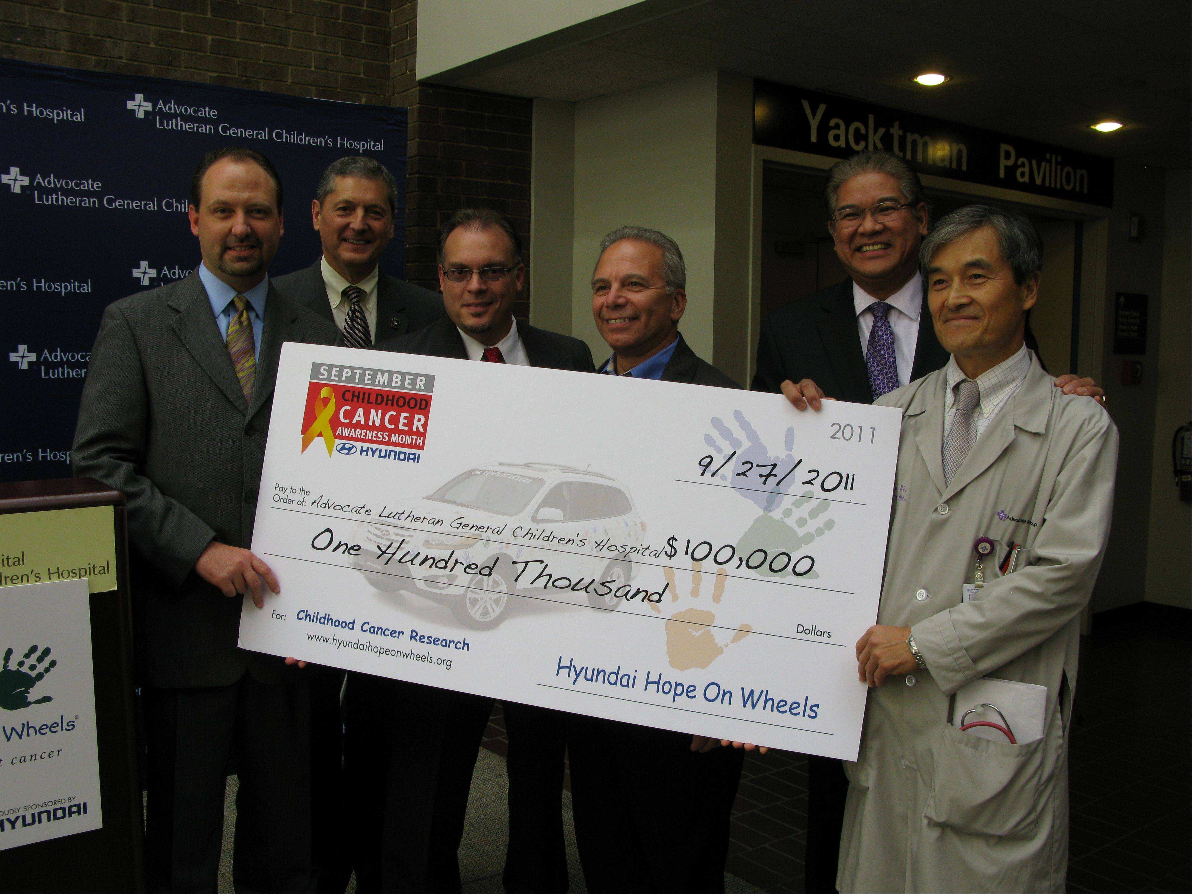 Paul Lamb, left, Hyundai regional sales manager, state Rep. David Harris, Enrique Perez, Schaumburg Hyundai sales manager, Dominic Pugliani, president of Downers Grove Hyundai, Anthony Armada, president of the hospital, and Dr. Jong-Hyo Kwon, pediatric oncologist, hold a replica of the check the hospital received.