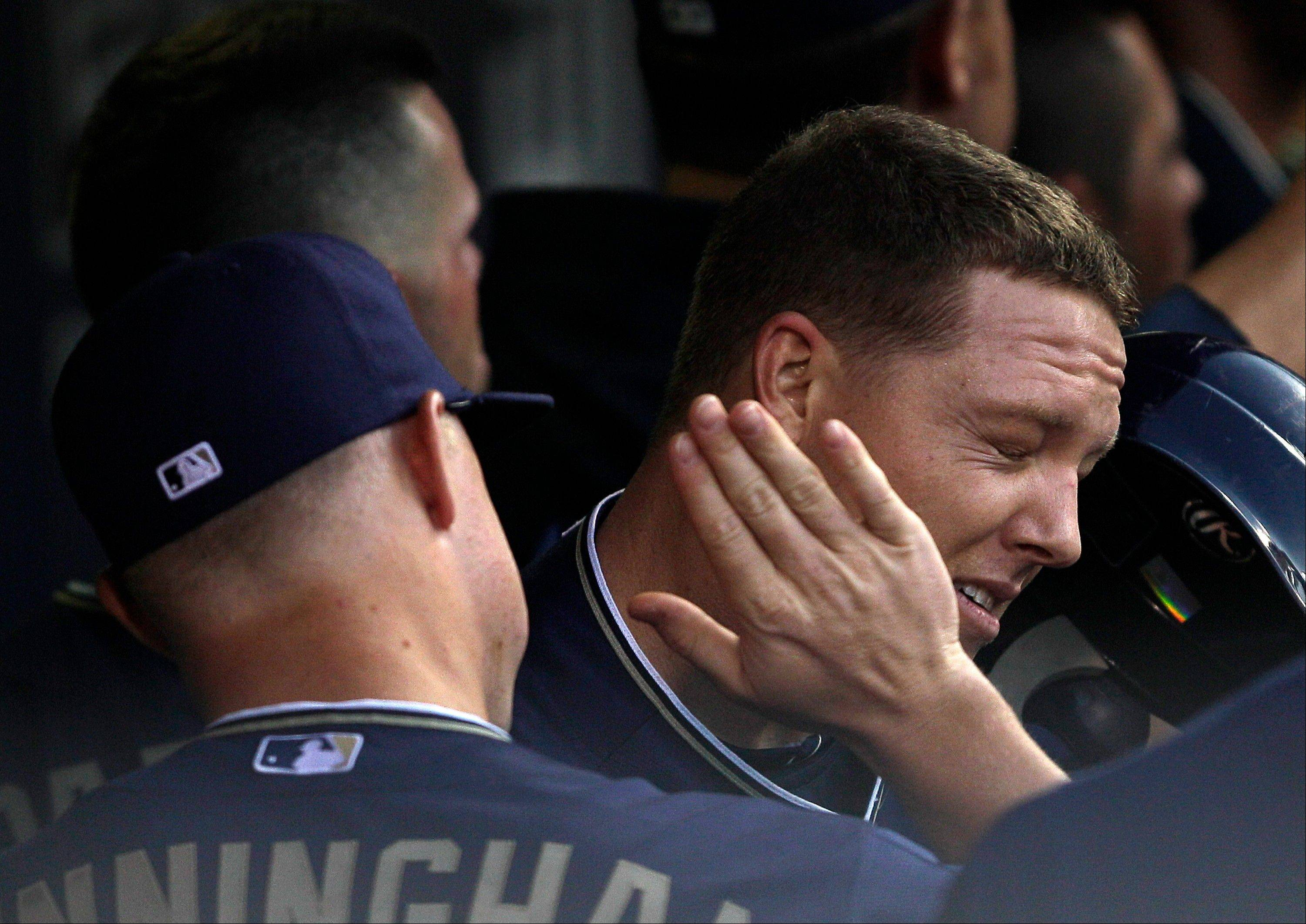The San Diego Padres' Nick Hundley, right, gets a slap from teammate Aaron Cunningham after hitting a 3-run home run against the Cubs during the third inning Wednesday.