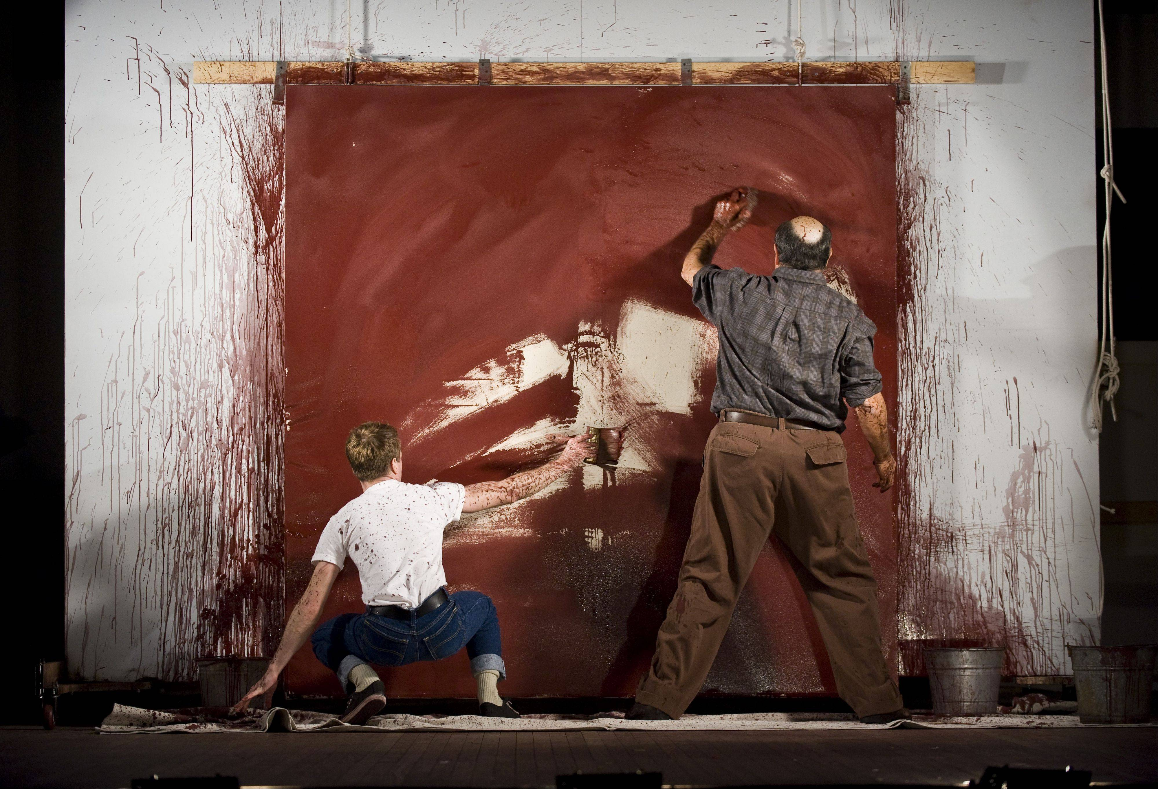 "Ken (Patrick Andrews, left) and Mark Rothko (Edward Gero) work feverishly to prime a canvas for one of Rothko's murals in Goodman Theatre's production of ""Red."""