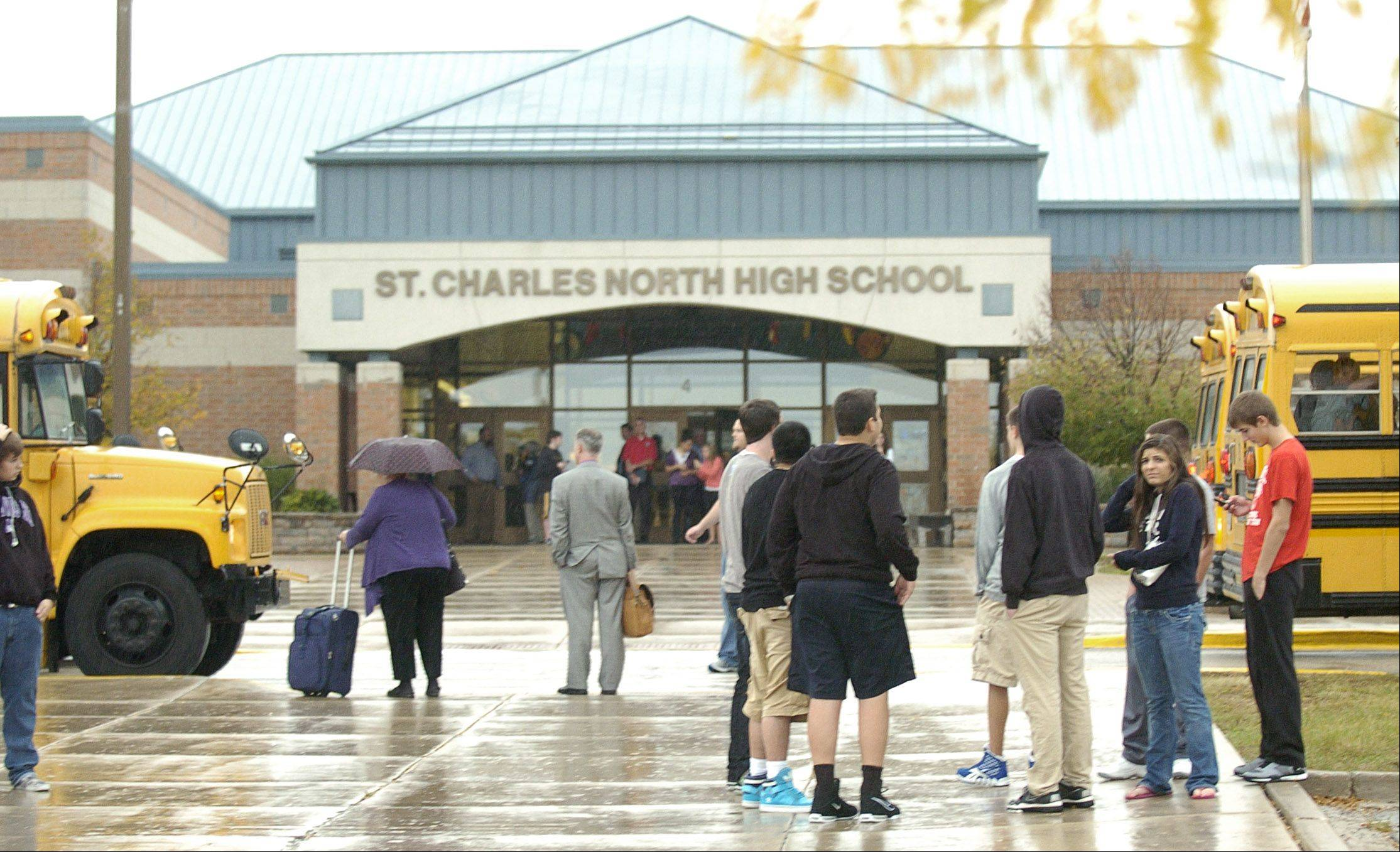 Evacuated students at St. Charles North High School load buses or wait for their parents to pick them up after the school was shut down following a �security breach� early Thursday afternoon. Students were not allowed to take their backpacks or coats, only their cellphones or other personal items.