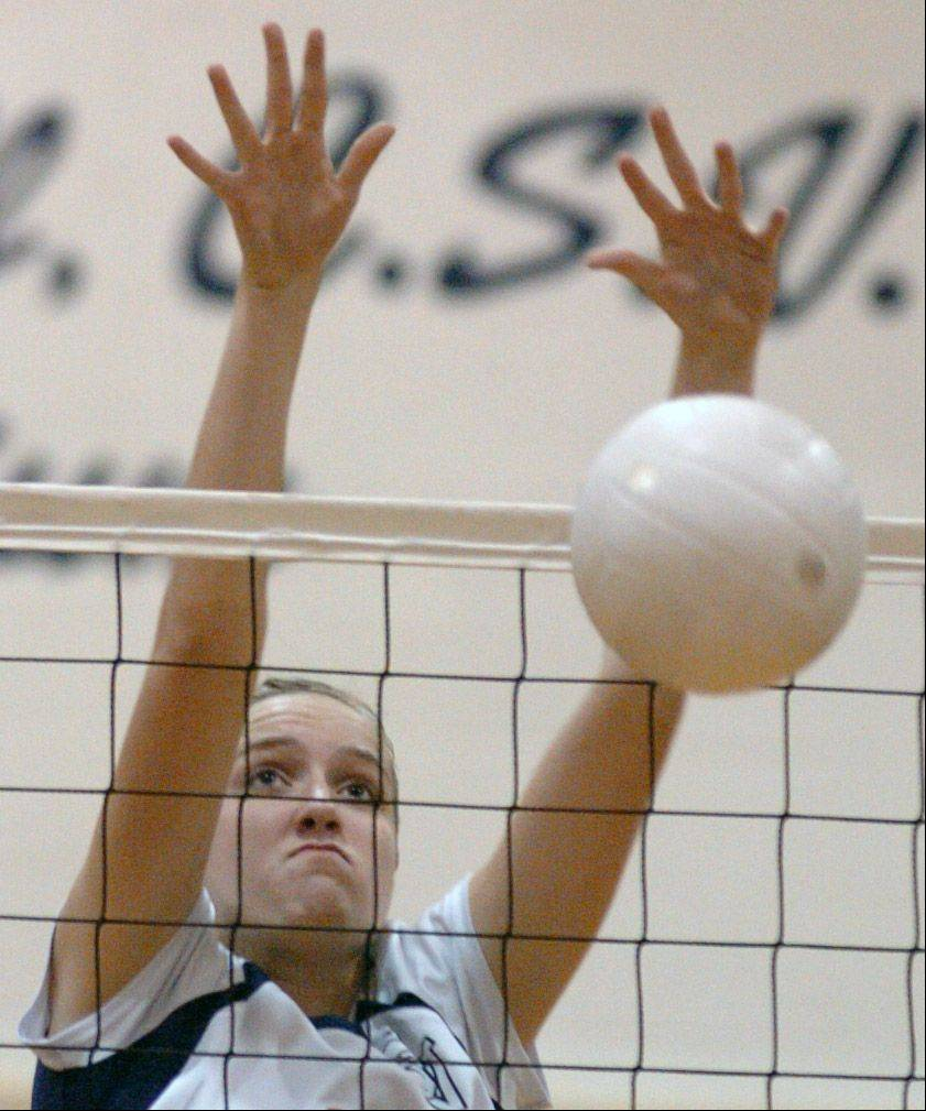 St. Viator�s Mary Cleary attempts to block a spike during Thursdays game between Fenwick and St. Viator at St. Viator High School. St. Viator won the match in two sets.