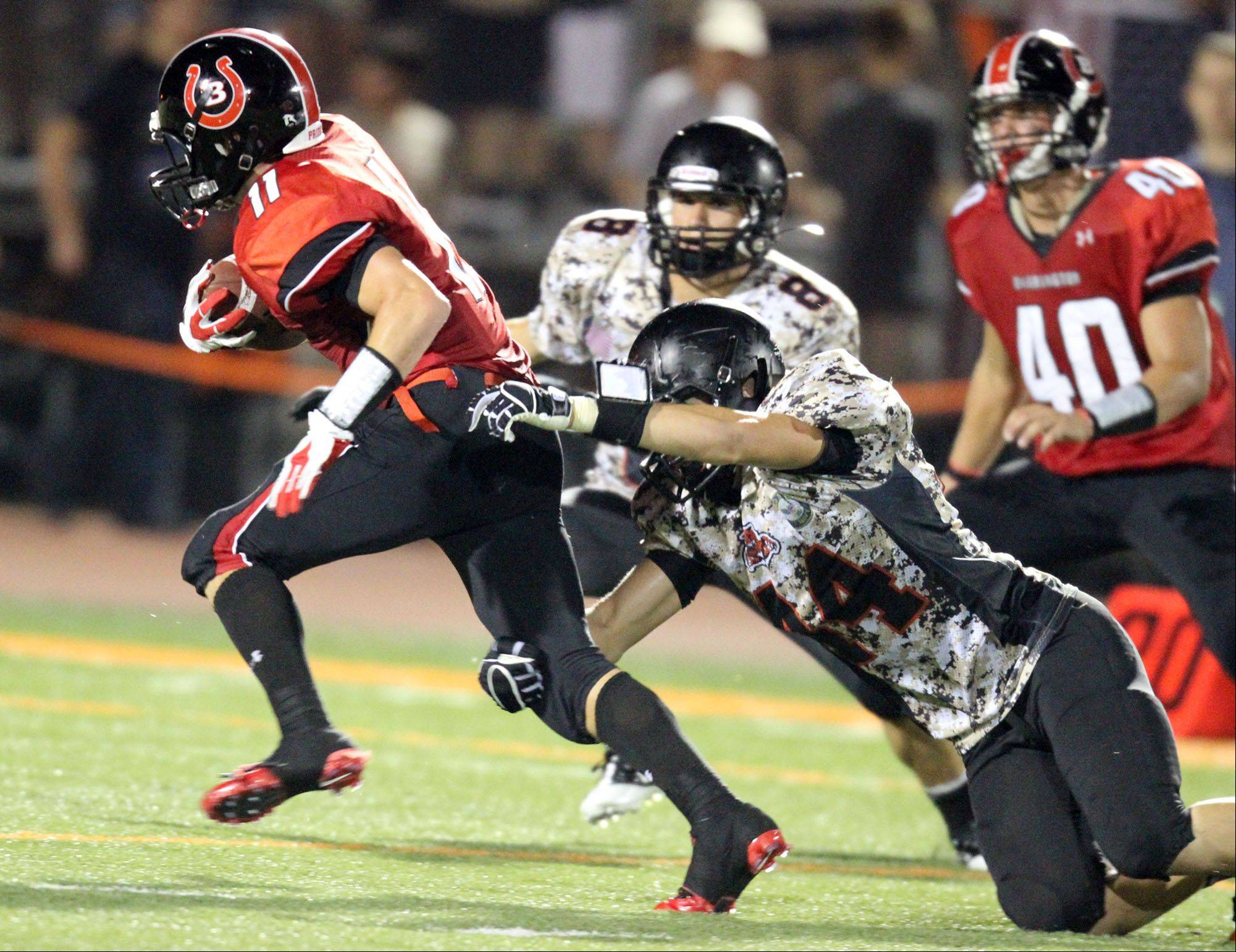 Barrington�s Dylan Zyzda slips past Libertyville defenders on opening night.